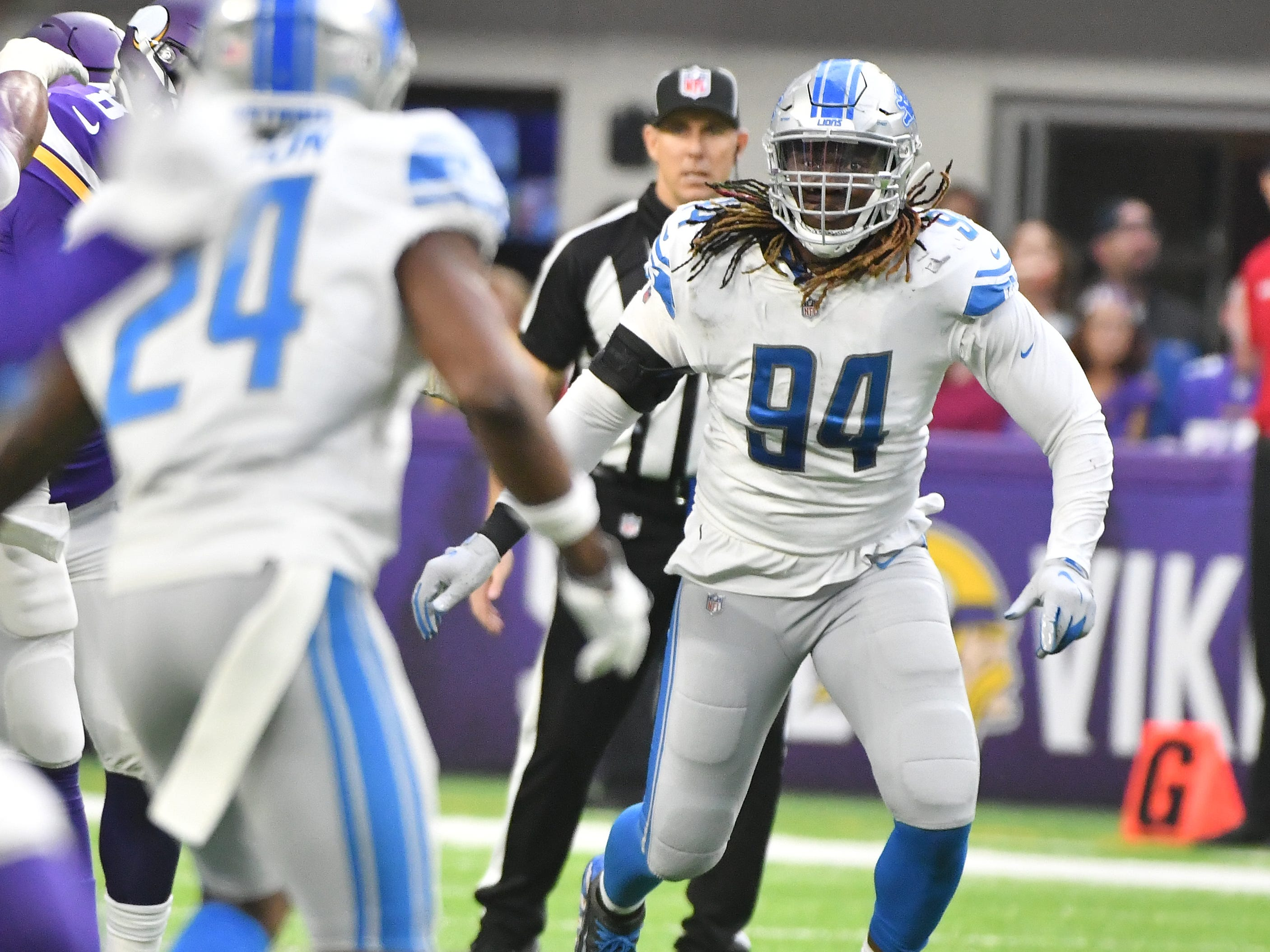 Lions' Ezekiel Ansah in on a play in the third quarter.