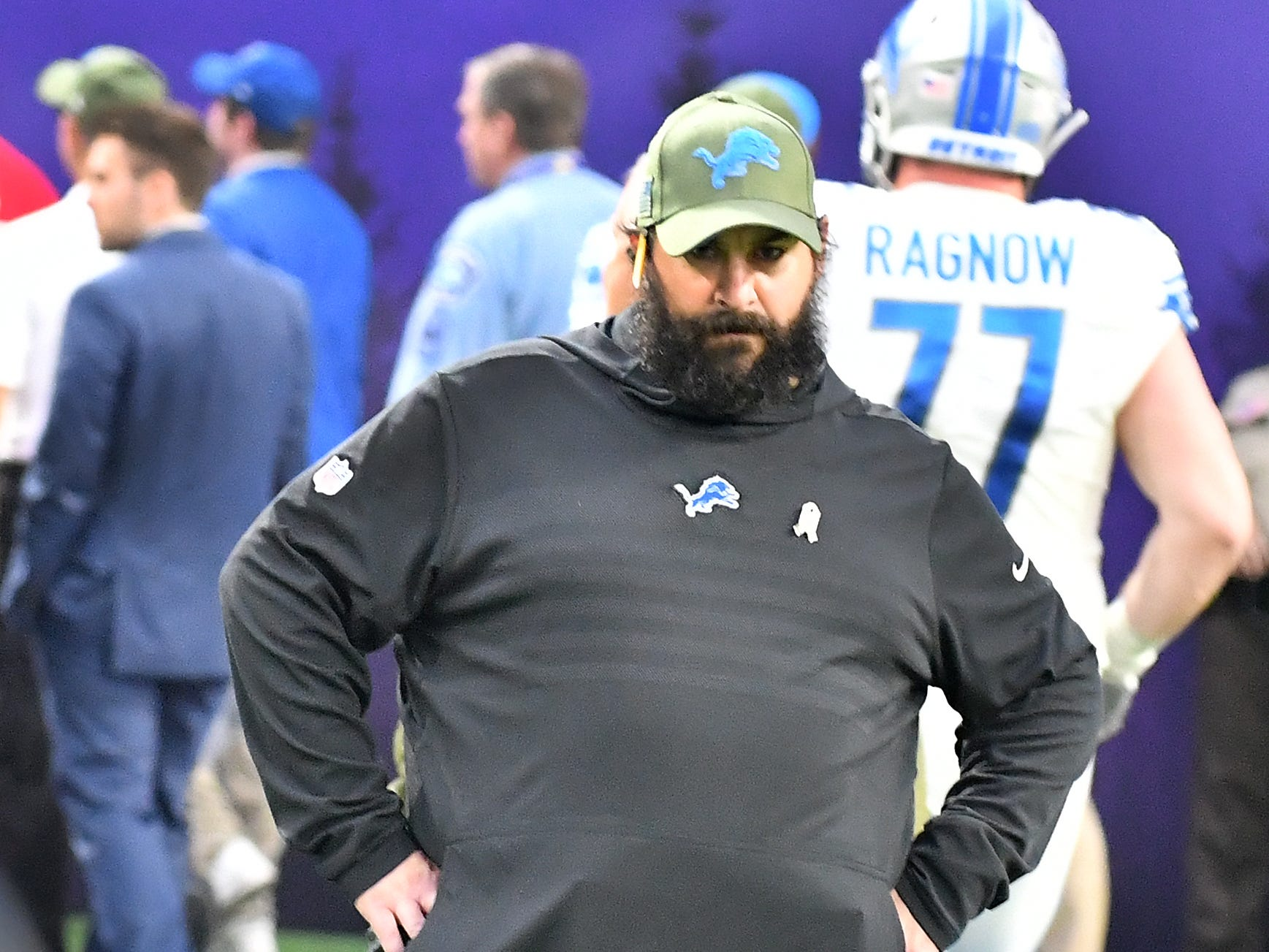 Detroit Lions head coach stands on the field waiting till all his players leave the field after losing to the Vikings 24-9.