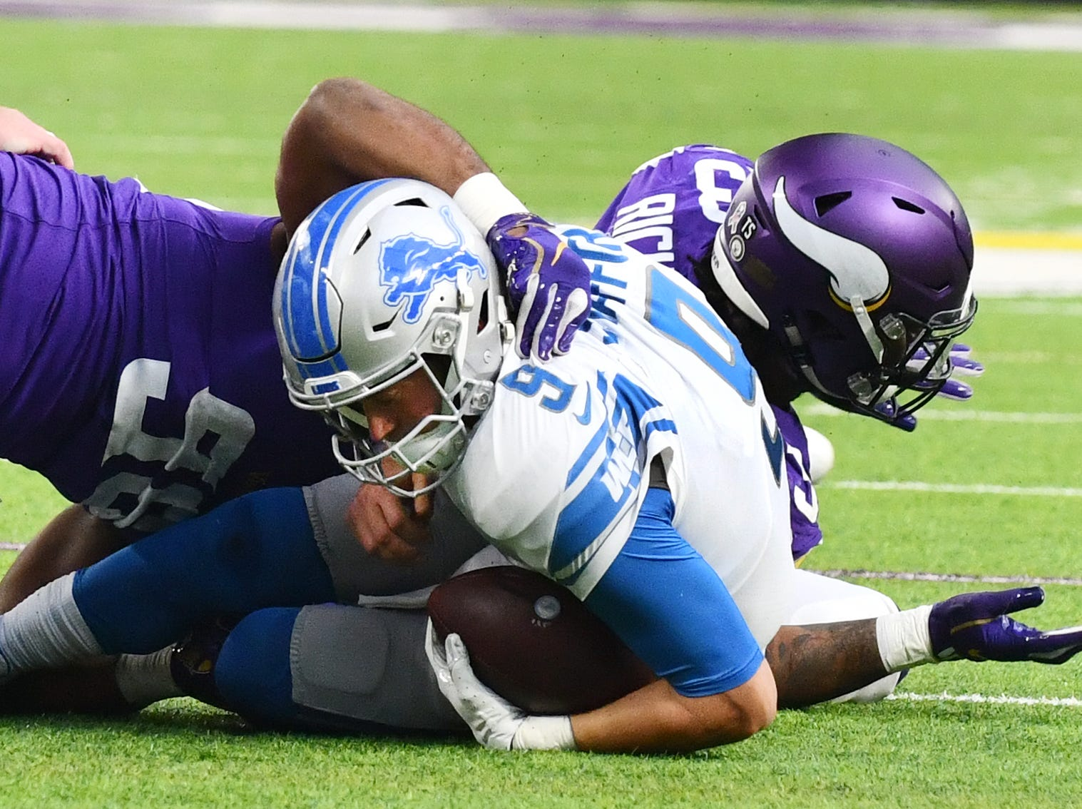 Vikings' Tom Johnson and Sheldon Richardson sack Lions quarterback Matthew Stafford in the second quarter.