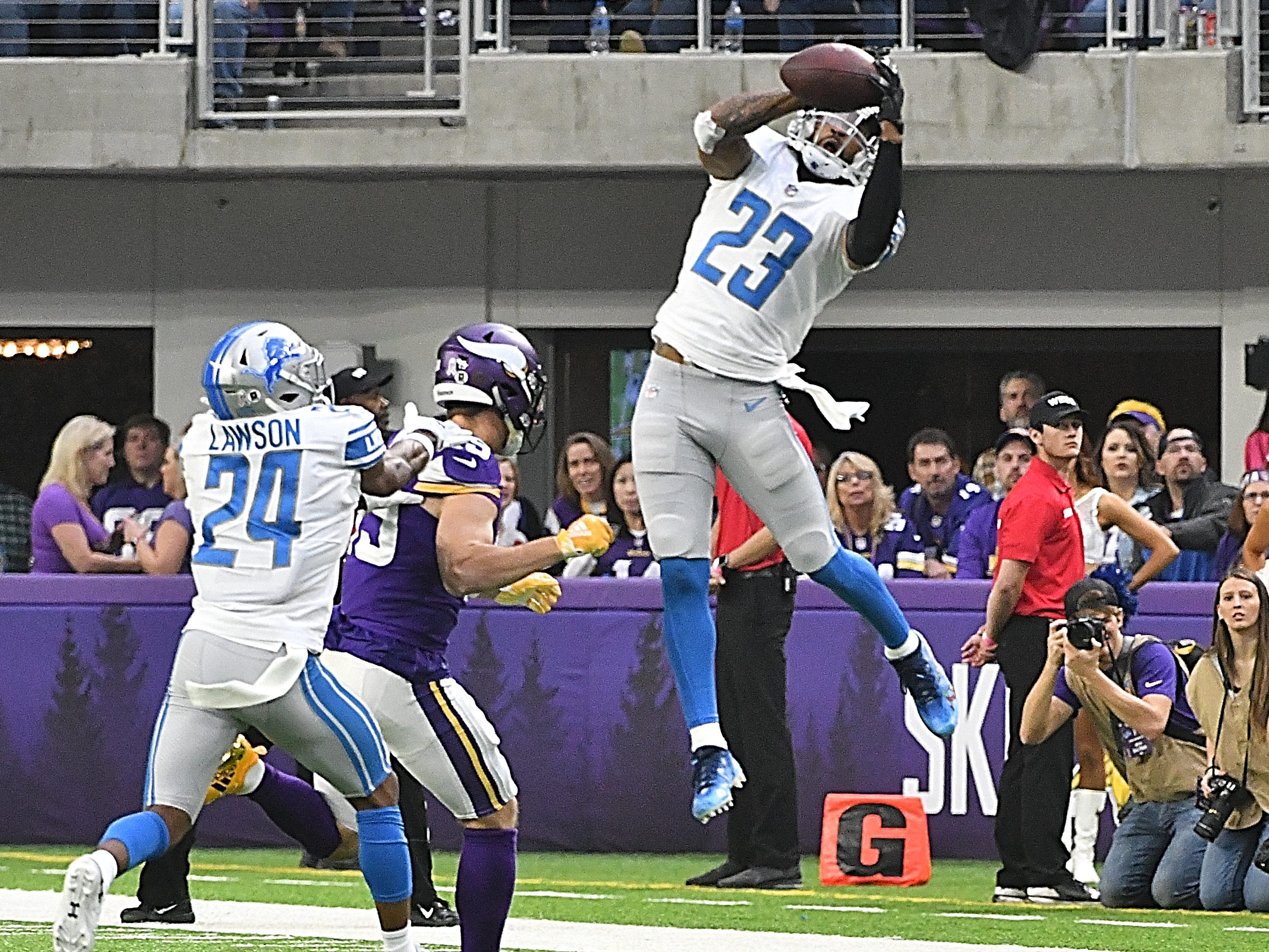 Lions' Darius Slay pulls down an interception intended for Vikings' Adam Thielen in the second quarter.
