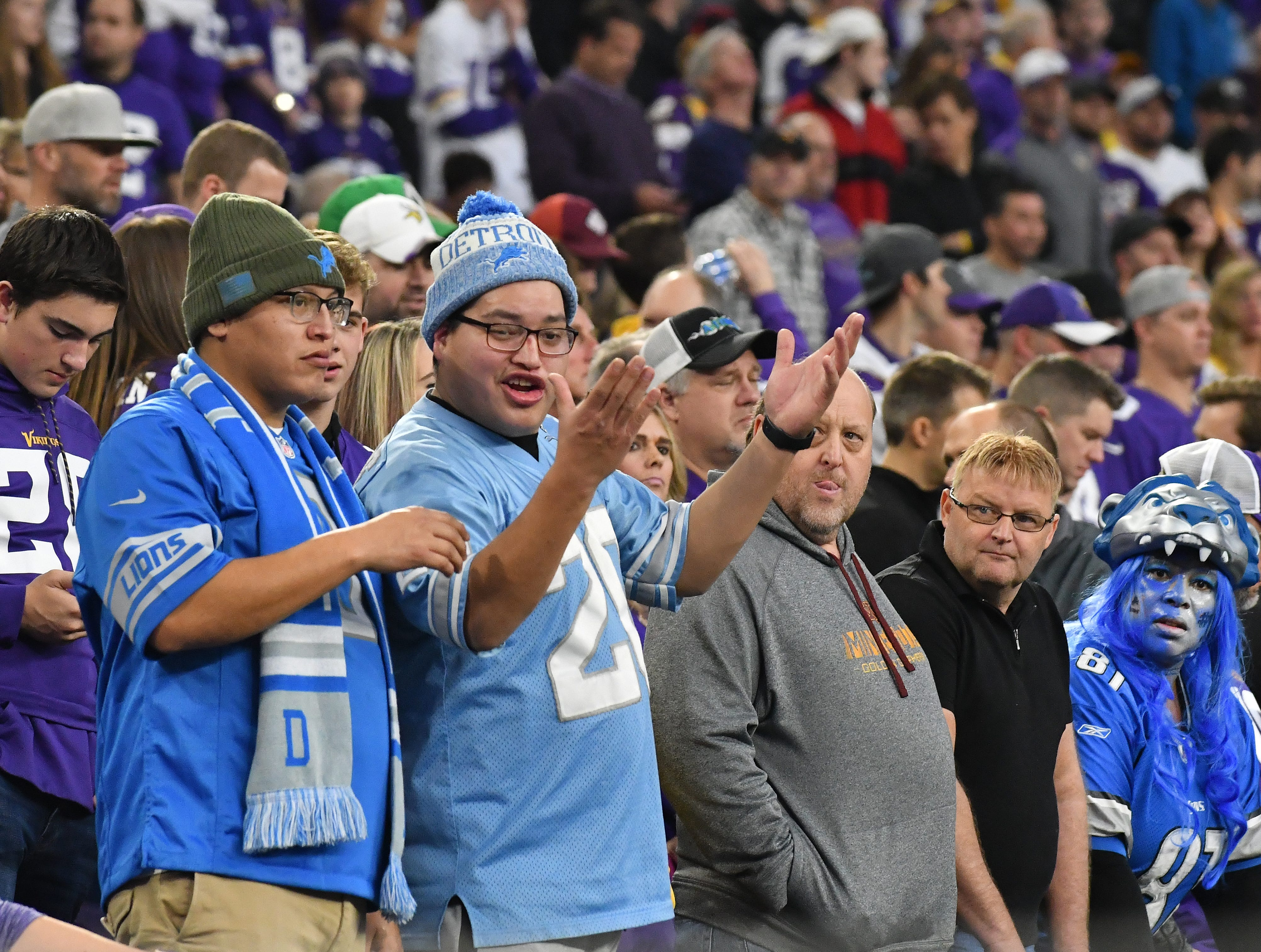 Lions fans throw their hands up late in the fourth quarter of the 24-9 loss to the Vikings.
