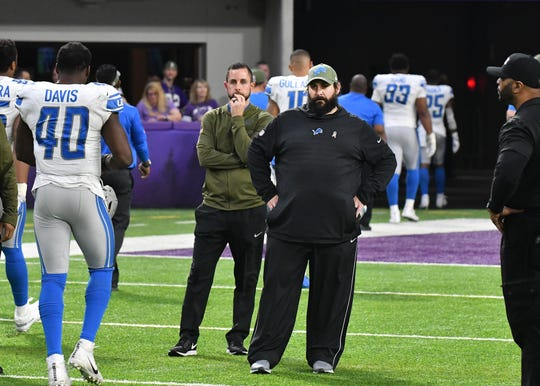 Lions head coach stands on the field waiting till all his players leave the field after losing to the Vikings last week.