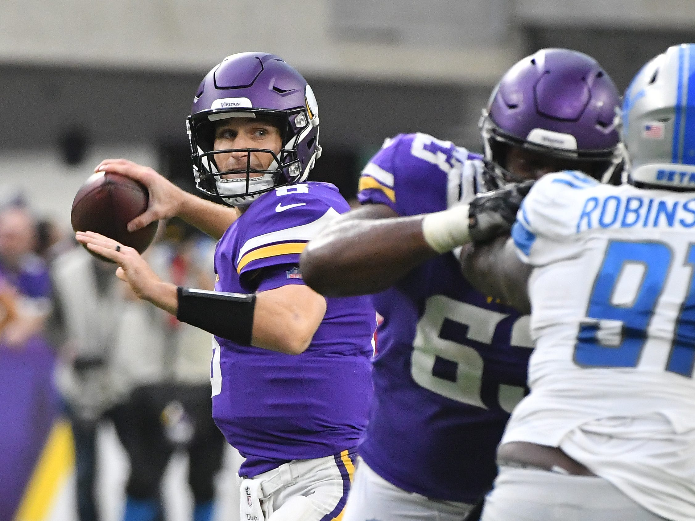 Vikings quarterback Kirk Cousins throws in the fourth quarter.