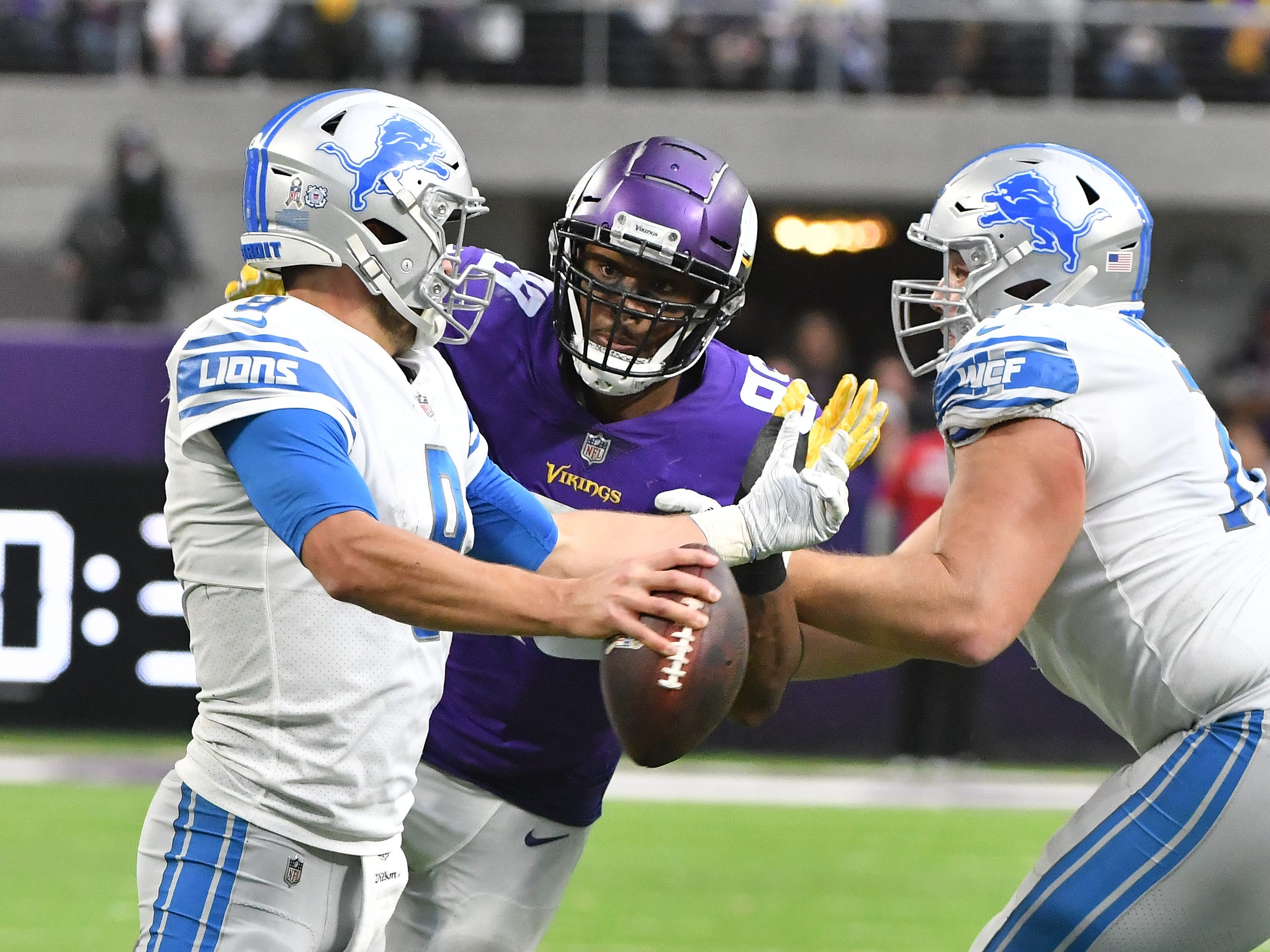 Vikings' Danielle Hunter eyes another sack of Lions quarterback Matthew Stafford, with Frank Ragnow defending, but only forces him out of the pocket, where his teammate Everson Griffen is waiting to bring down Stafford in the third quarter.