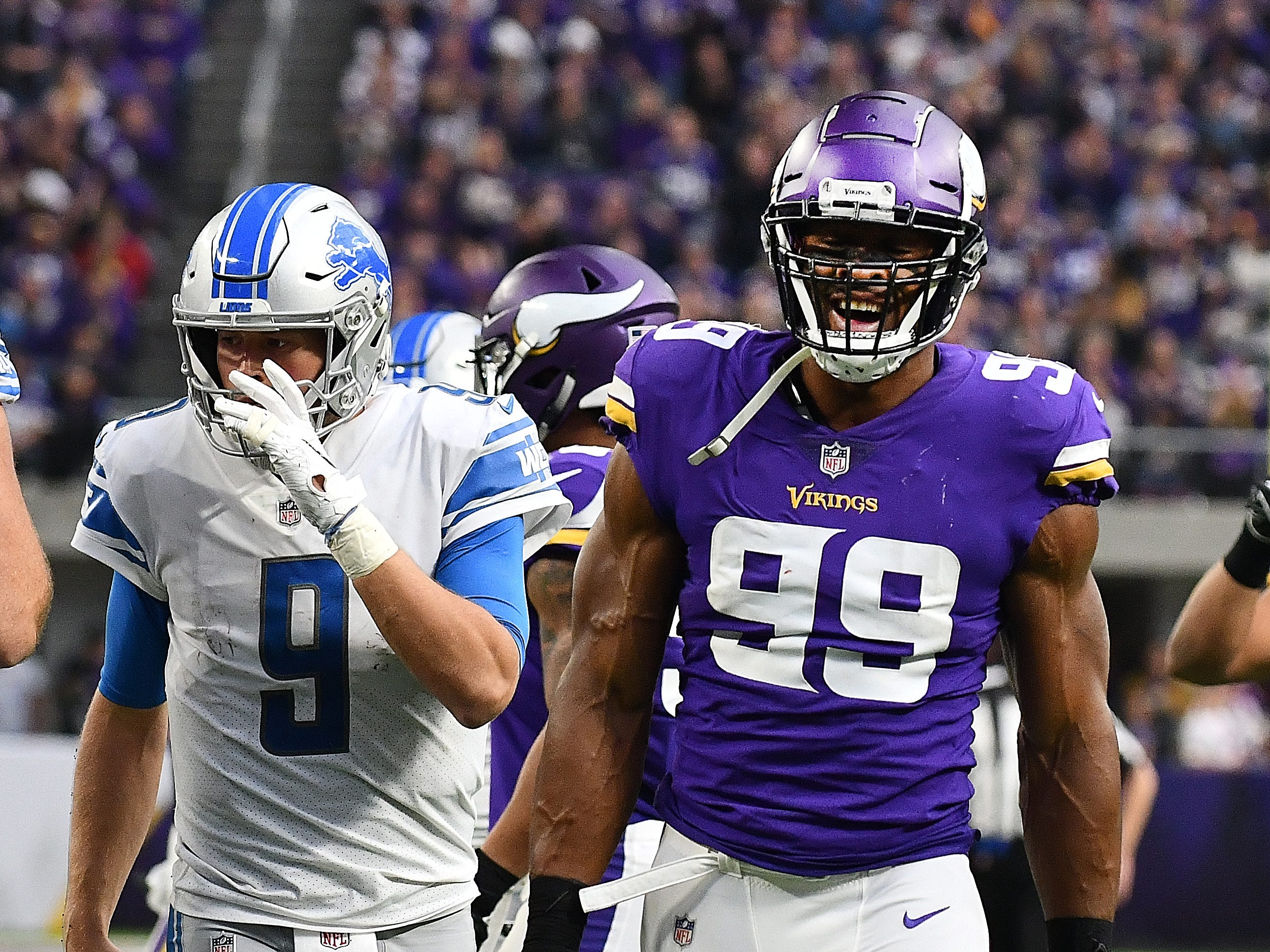 Vikings' Danielle Hunter is all smiles after his sack of Lions quarterback Matthew Stafford in the third quarter.