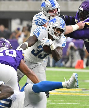 Lions running back Kerryon Johnson looks for an opening in the defense in the second quarter.