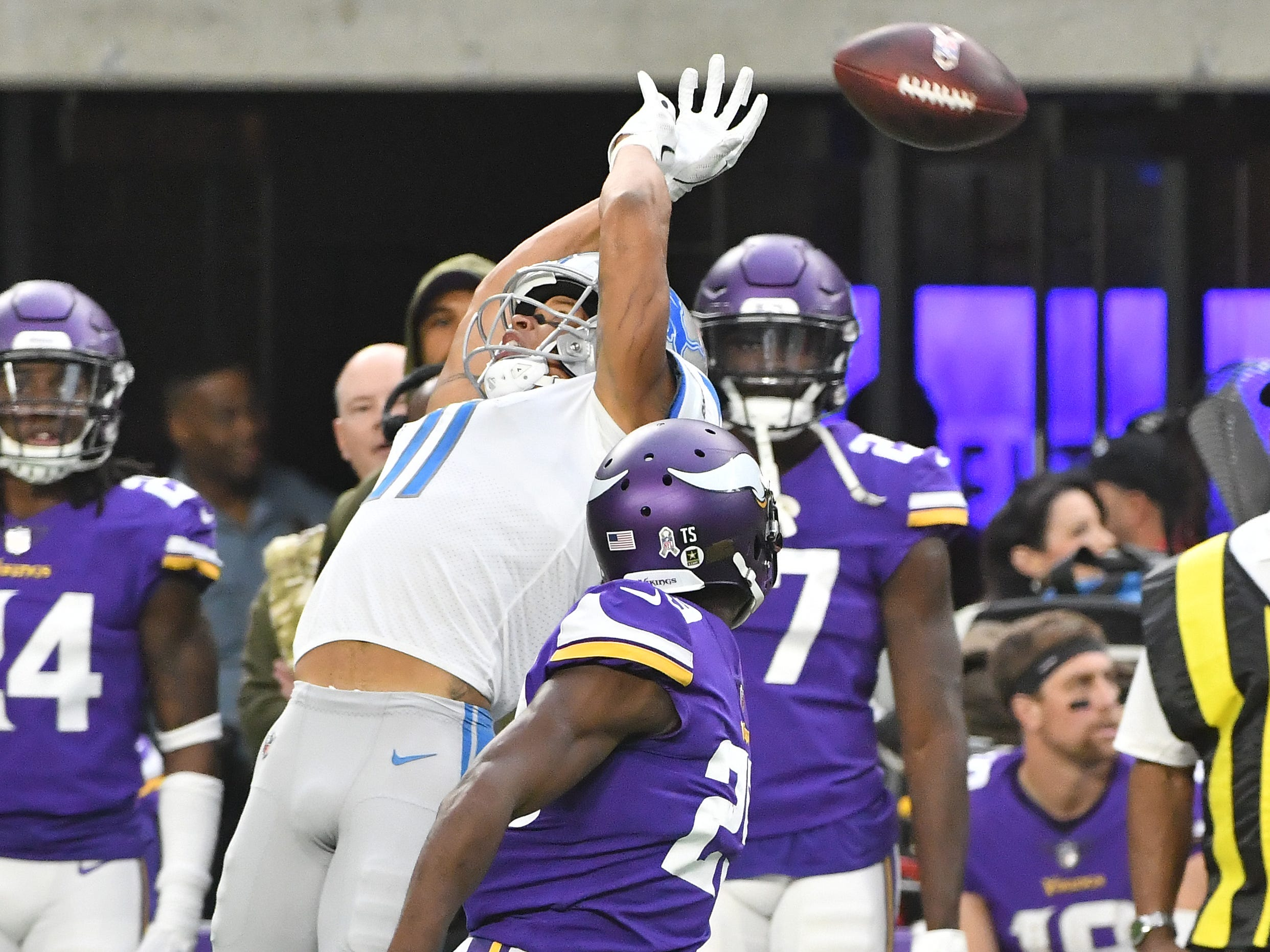 Lions' Marvin Jones Jr. can't pull down a high pass along the sidelines with Vikings' Xavier Rhodes defending in the second quarter.