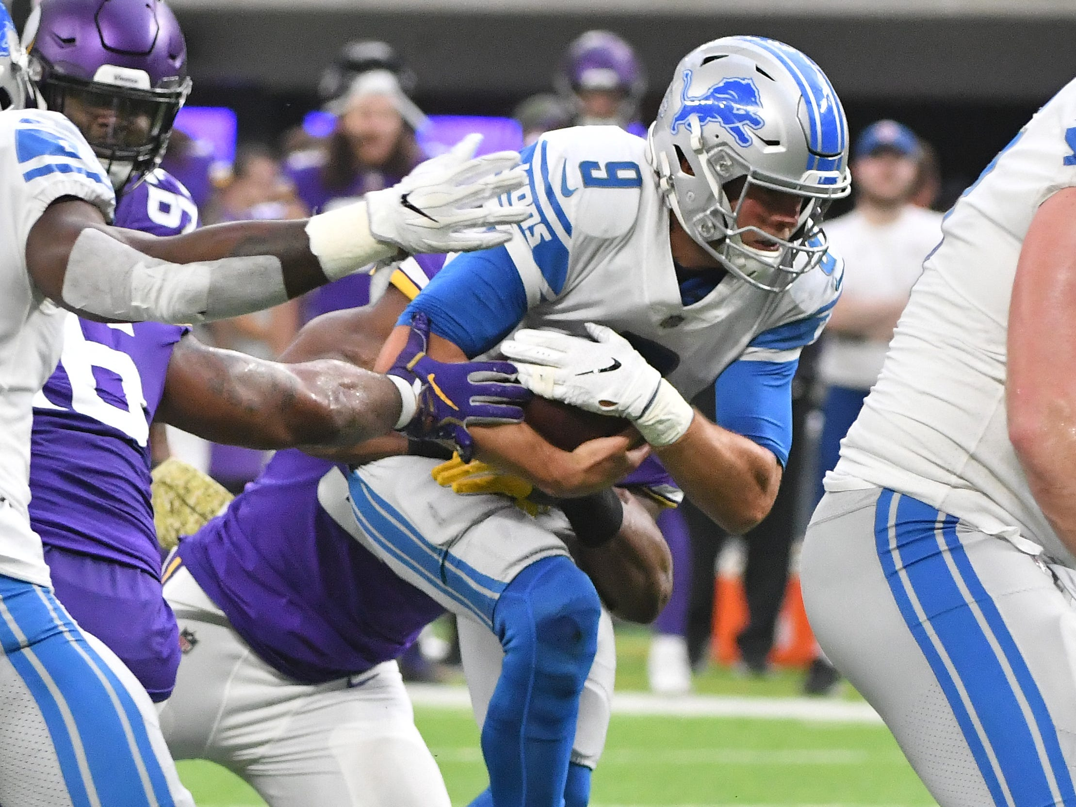 Lions quarterback Matthew Stafford sacked by Vikings' Danielle Hunter in the second quarter.