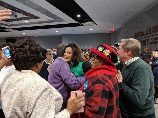 Michigan Democratic gubernatorial candidate Gretchen Whitmer, center, gets a huge at an IBEW union hall in Detroit before a Sunday (Nov. 4, 2018) rally. Former Gov. James Blanchard, right, offers encouragement.