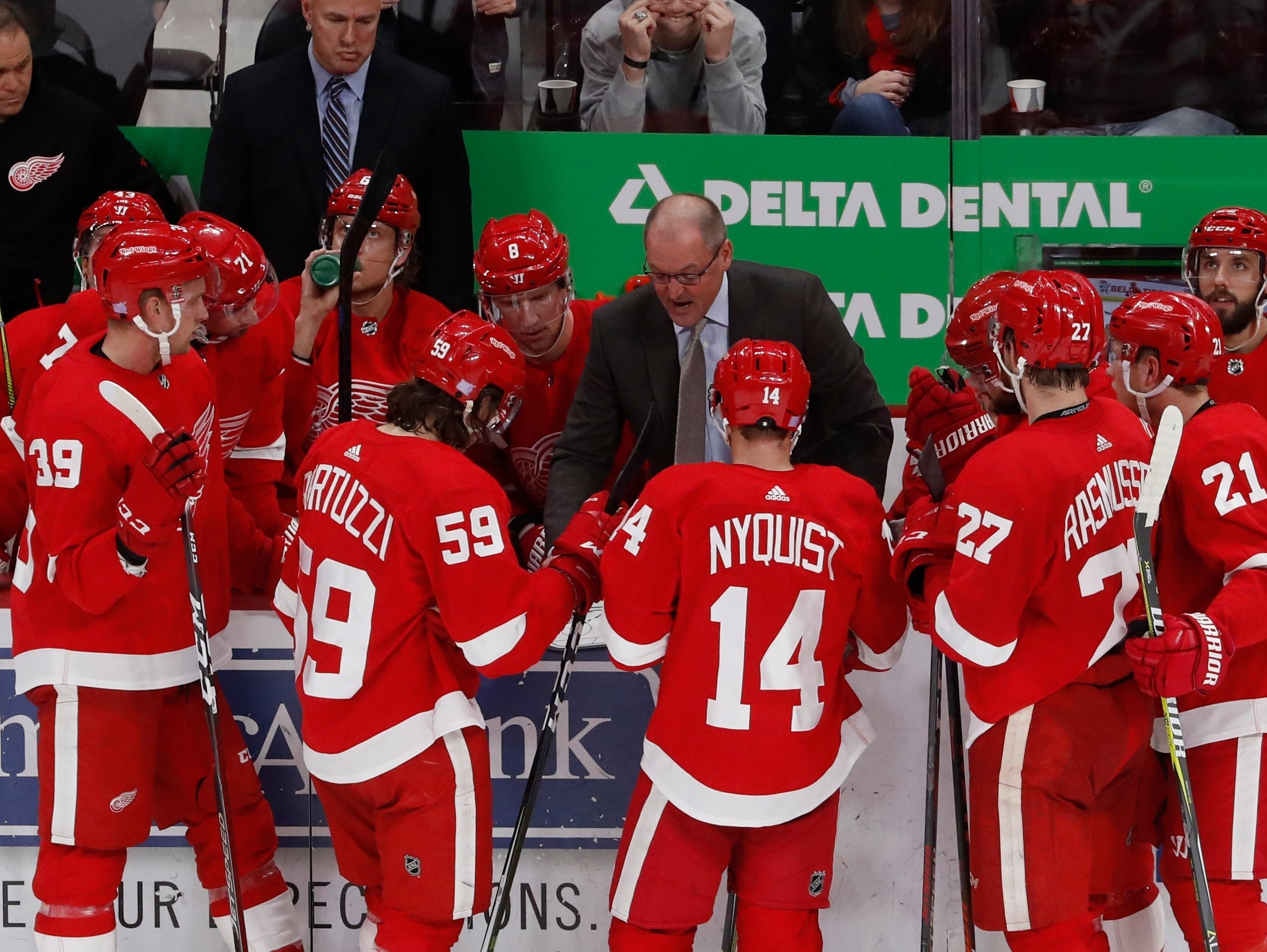 Detroit Red Wings assistant coach Dan Bylsma talks to the team during the third period of an NHL hockey game against the Edmonton Oilers, Saturday, Nov. 3, 2018, in Detroit. (AP Photo/Carlos Osorio)