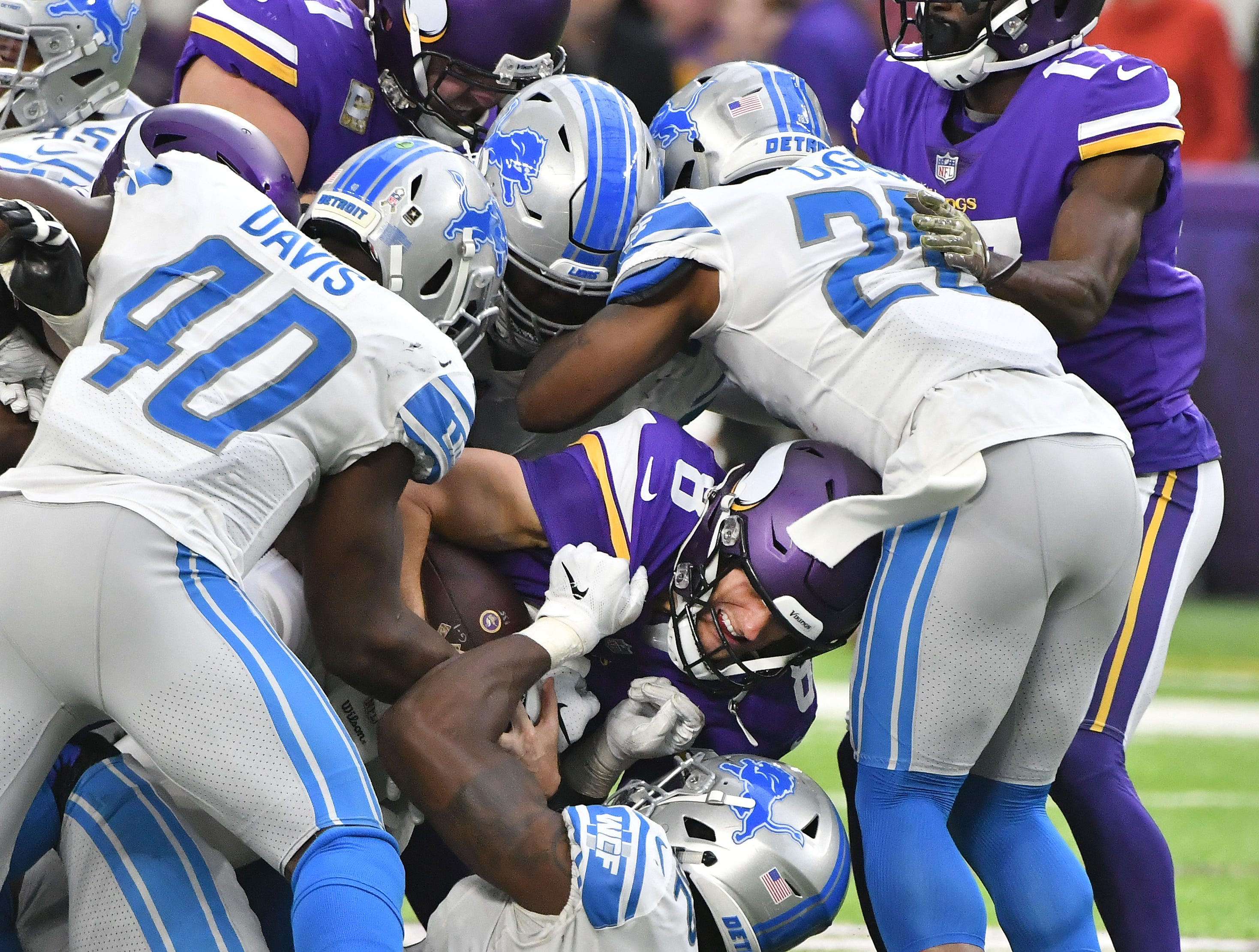 The Lions defense brings down Vikings quarterback Kirk Cousins but after he picks up the yard for a first down on a quarterback sneak in the third quarter.