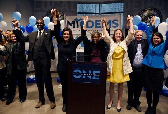 Democratic candidates raise their arms in unity at the end of the rally.  There will be a get-out-the-vote rally in Detroit with the major Democratic statewide candidates at IBEW Local 58. November 4, 2018, Detroit, MI.