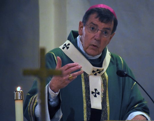 """As hundreds of worshippers fill the pews for a monthly """"Mass Mob,"""" Archbishop Allen Vigneron presides over a 175th Eucharistic Celebration Mass."""