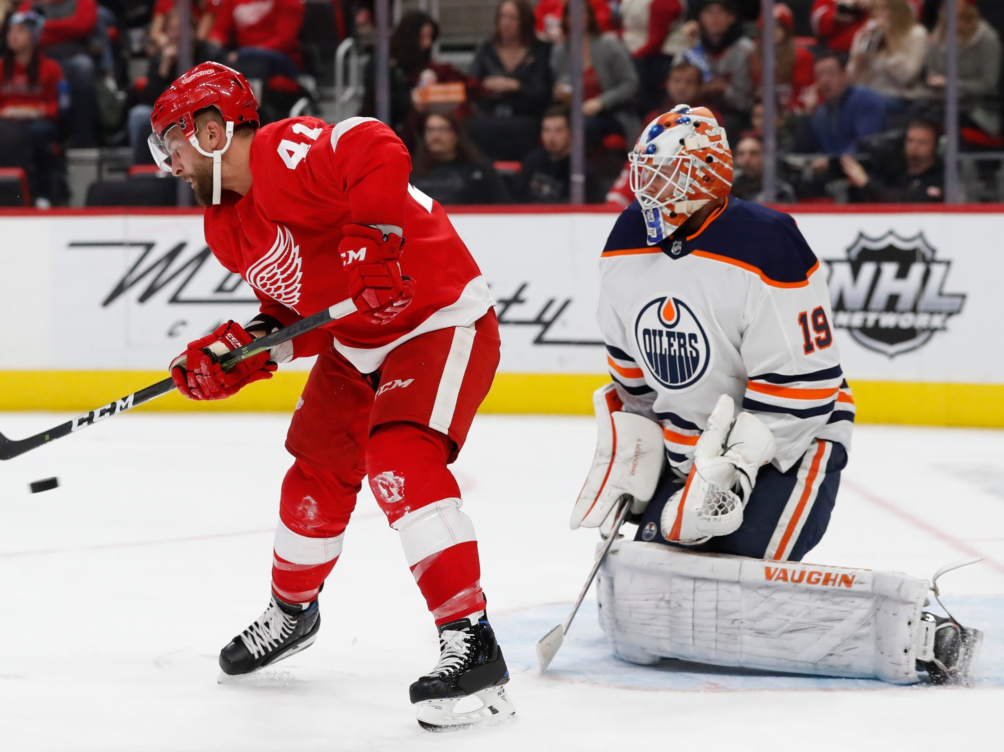 Detroit Red Wings center Luke Glendening (41) attempts diverting the puck past Edmonton Oilers goaltender Mikko Koskinen (19) during the second period of an NHL hockey game, Saturday, Nov. 3, 2018, in Detroit. (AP Photo/Carlos Osorio)