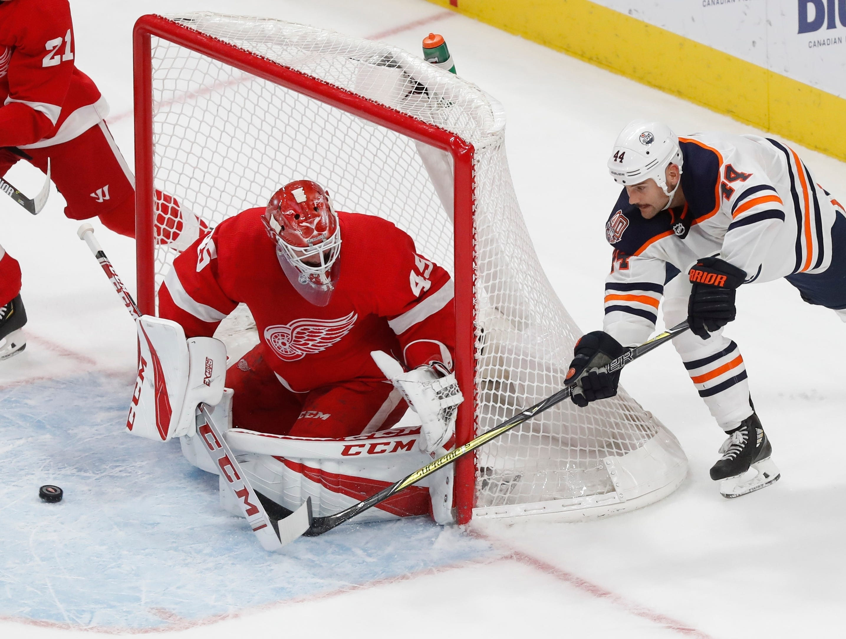 Detroit Red Wings goaltender Jonathan Bernier (45) deflects a shot by Edmonton Oilers right wing Zack Kassian (44) during the third period of an NHL hockey game, Saturday, Nov. 3, 2018, in Detroit. Edmonton won, 4-3. (AP Photo/Carlos Osorio)
