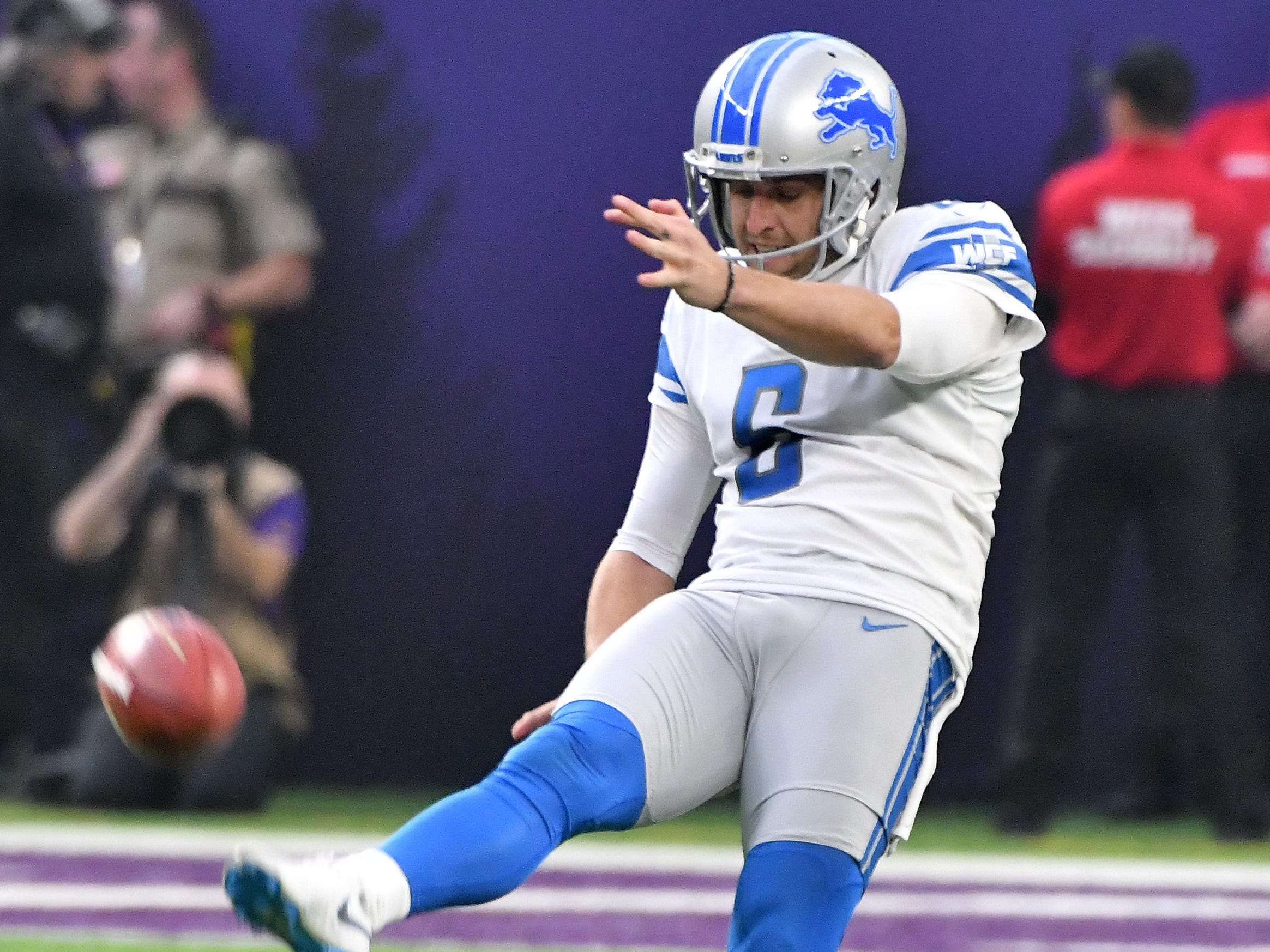 Lions punter Sam Martin punts in the first quarter.
