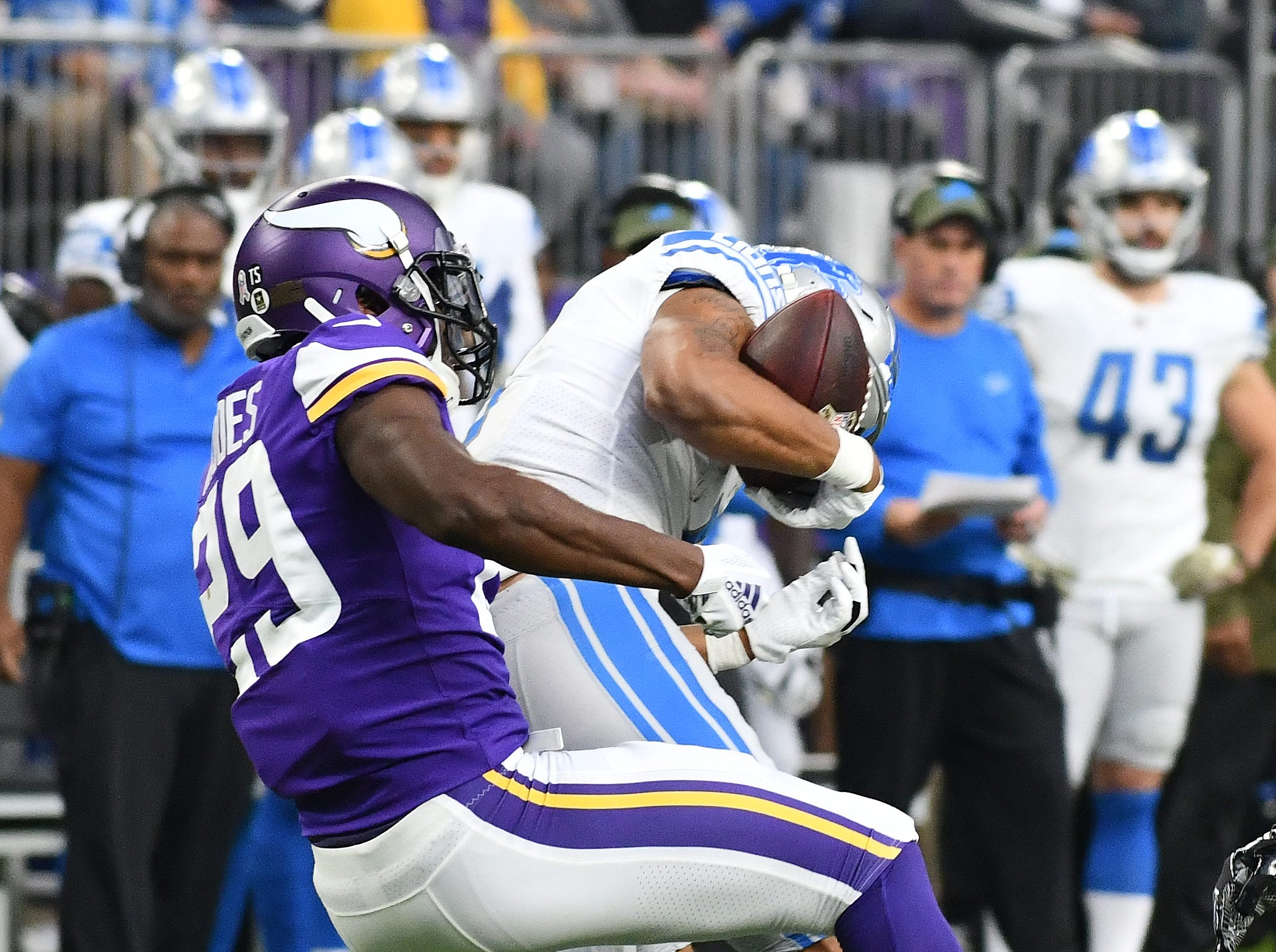 Lions wide receiver Marvin Jones Jr. loses the ball as Vikings' Xavier Rhodes hits him but fortunately for Detroit, the ball rolled out of bounds in the third quarter.