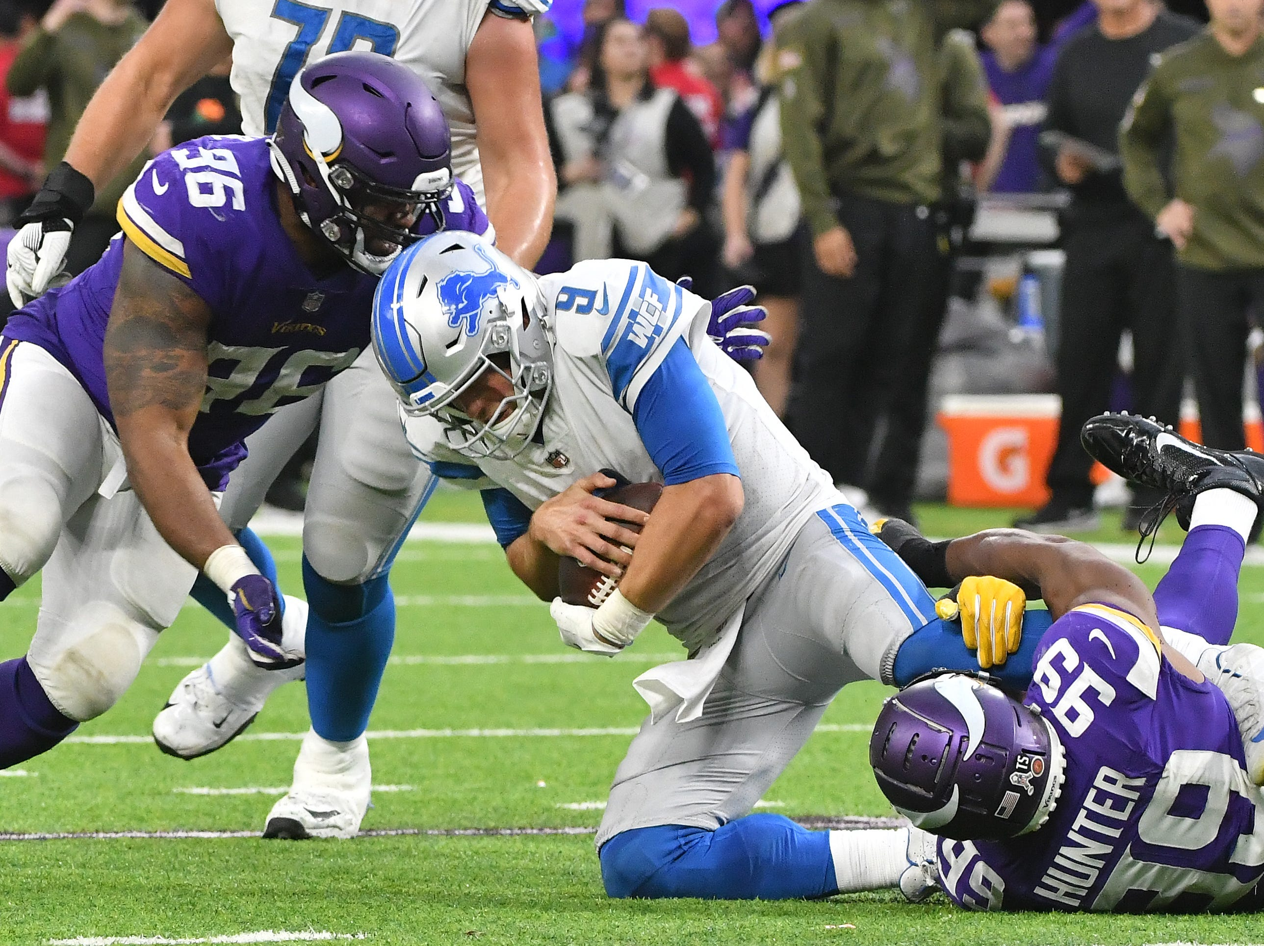 Lions quarterback Matthew Stafford is sacked for the 10th time, this time by Vikings' Everson Griffen and Danielle Hunter late in the fourth quarter.
