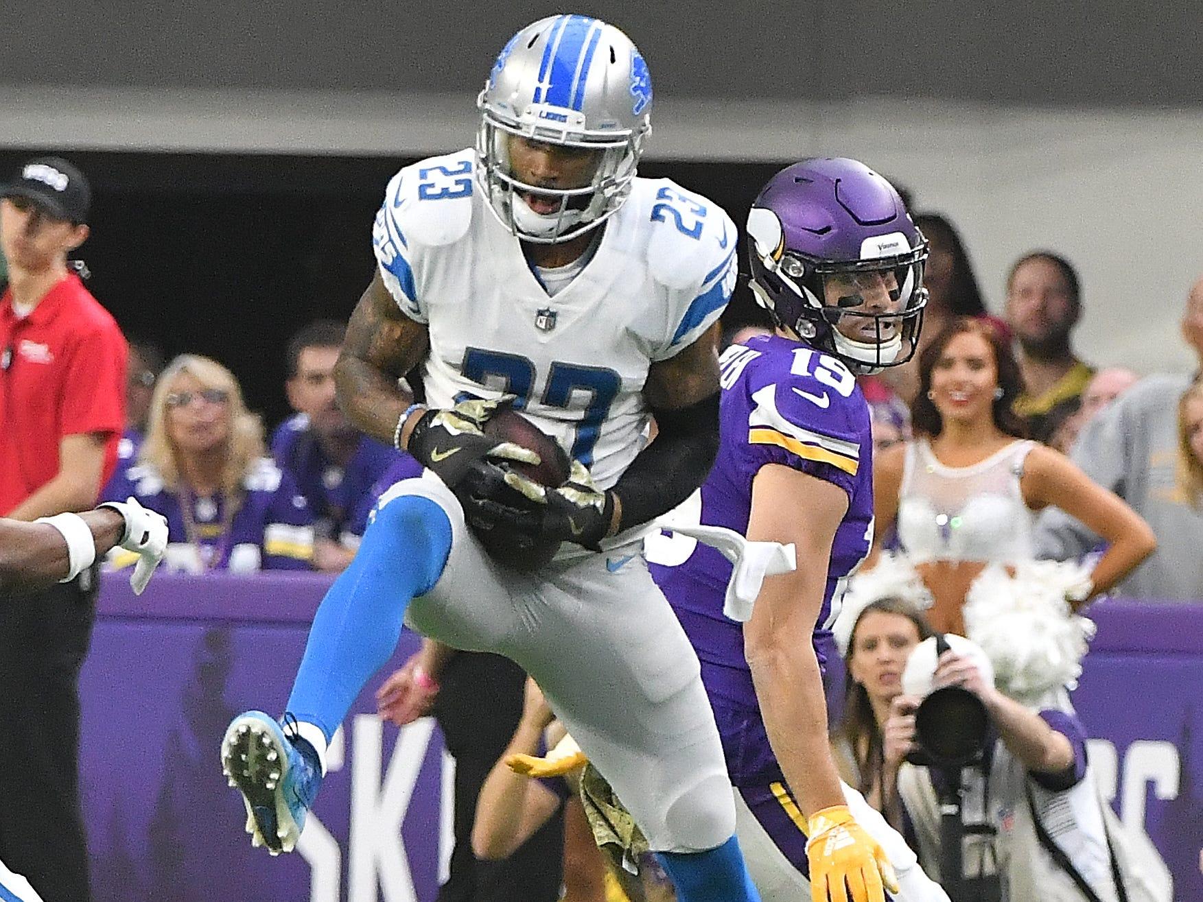 Lions' Darius Slay pulls down an interception intended for Vikings' Adam Thielen in the second quarter. NFL Detroit Lions vs. Minnesota Vikings at U.S. Bank Stadium in Minneapolis, Minnesota on November 4, 2018.