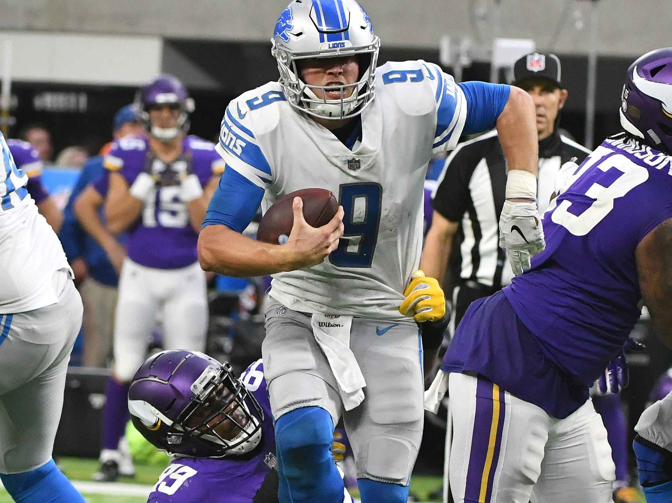 Lions quarterback Matthew Stafford is going nowhere as  Vikings' Danielle Hunter ties up Stafford's leg late for another sack, this one in the fourth quarter, of the 24-9 loss to Minnesota at U.S. Bank Stadium in Minneapolis, Minnesota on November 4, 2018.