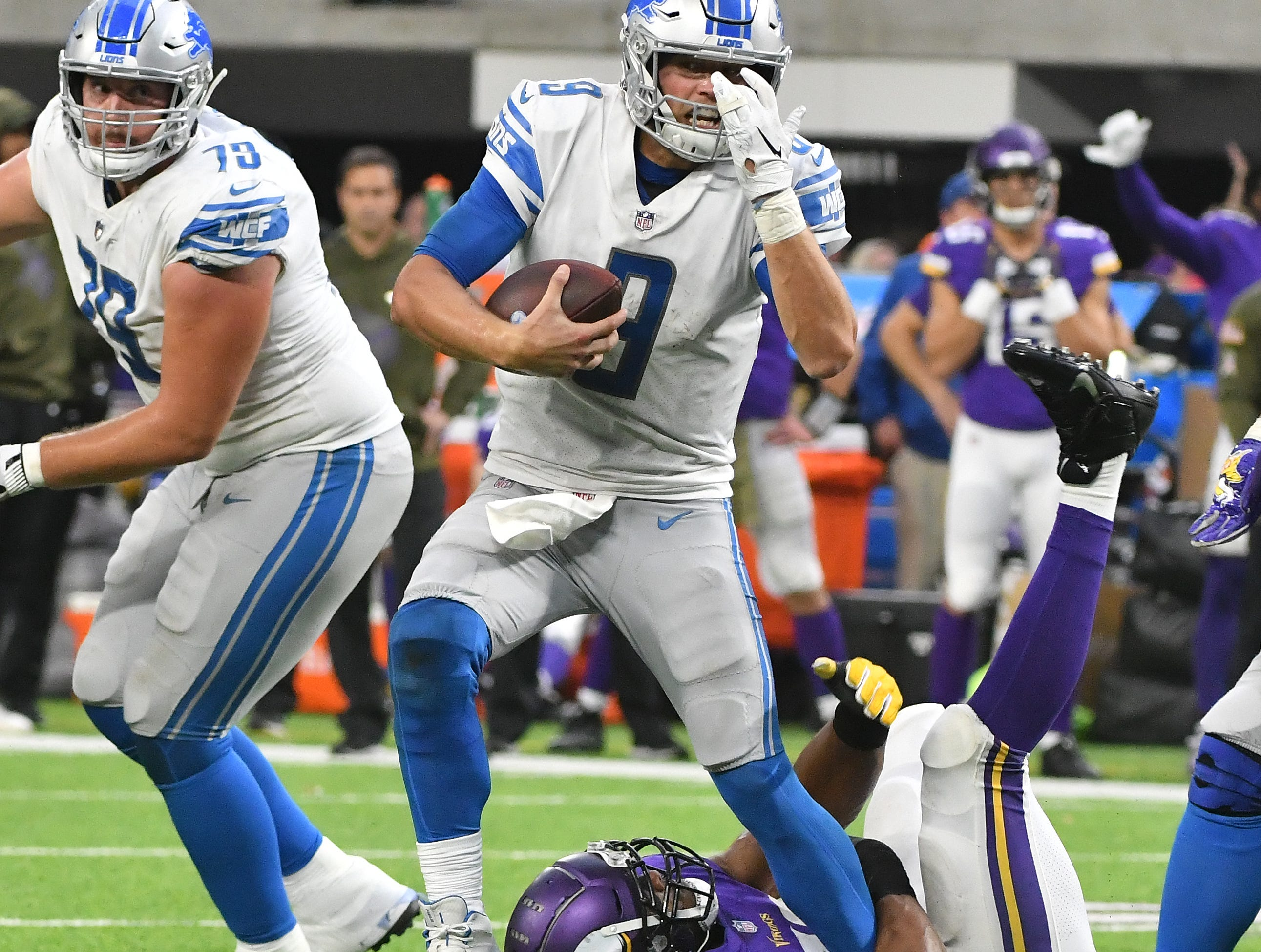 Lions quarterback Matthew Stafford is going nowhere as  Vikings' Danielle Hunter ties up Staffords leg late in the fourth quarter.