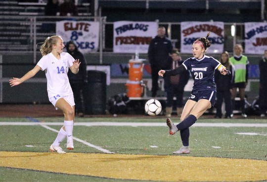 Emma Bough of Chenango Forks kicks the ball ahead in front of Rachael Peacock of Bronxville during a Class B girls soccer state quarterfinal Nov. 3, 2018 at Vestal High School.