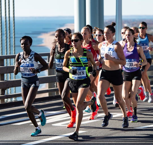 Elmira native Molly Huddle, far right, runs with the leaders during the TCS New York City Marathon on Nov. 4, 2018.