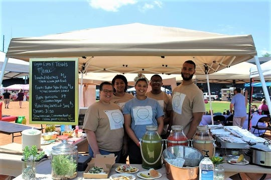 The Vegan Eats and Treats crew at the Evansville Food Truck Festival: From left, Kintina Chapman, Teya Chapman, Tori Chapman,  Daryl Chapman, and Ryan Herring.