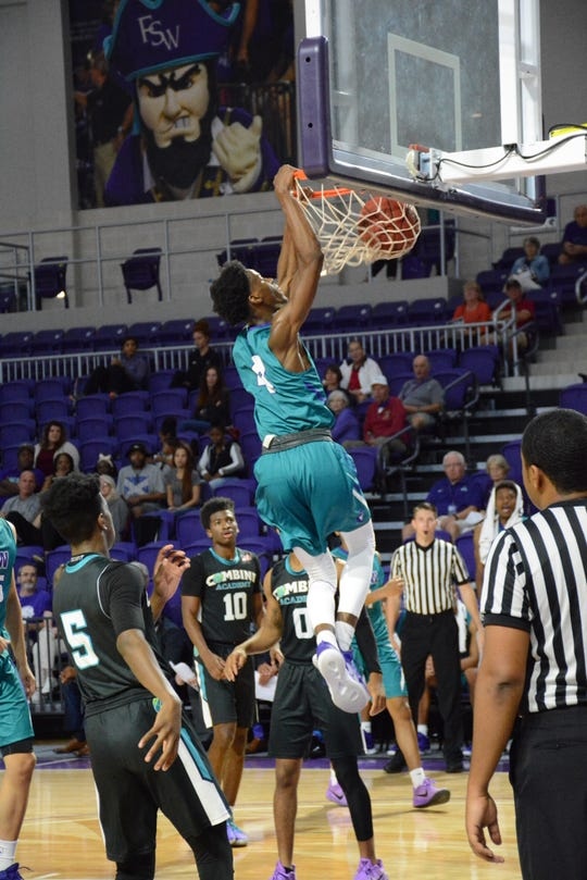 FSW's Keon Ellis dunks during the FSW men's basketball team's 90-69 win over Combine Academy Saturday, Nov. 3 at Suncoast Arena.