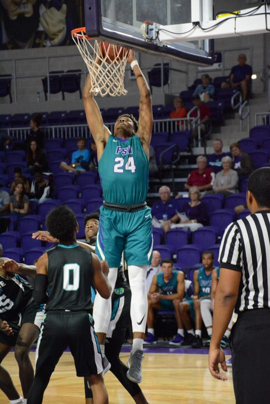 FSW's DeShawn Thomas dunks during  a 90-69 win over Combine Academy Saturday, Nov. 3 at Suncoast Arena.