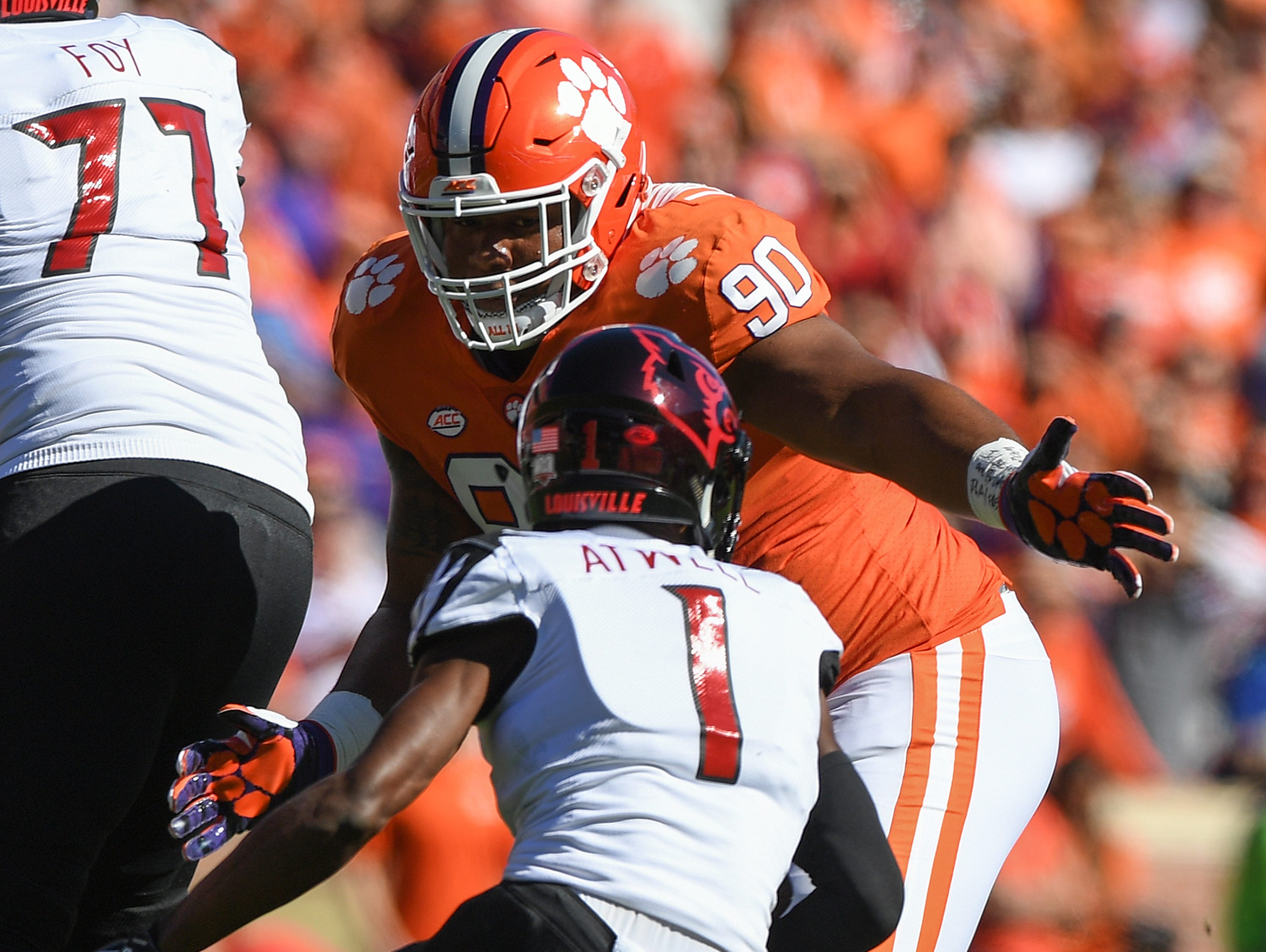 Clemson defensive lineman Dexter Lawrence (90) bears down on Louisville wide receiver Chatarius Atwell (1) during the 1st quarter Saturday, November 3, 2018 at Clemson's Memorial Stadium.