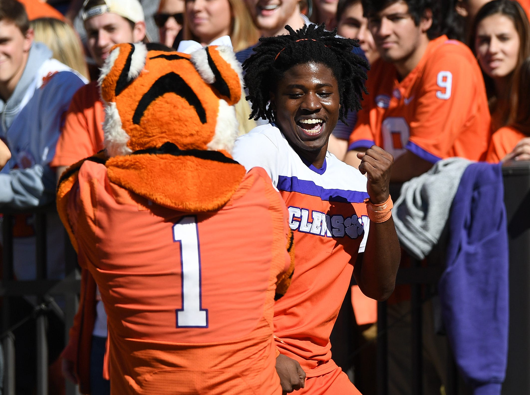 The Clemson Tiger dances with a cheerleader during the 2nd quarter Saturday, November 3, 2018 at Clemson's Memorial Stadium.