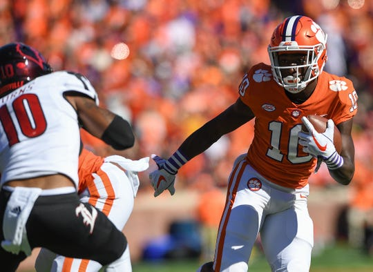 Clemson wide receiver Derion Kendrick (10) carries against Louisville during the 1st quarter Saturday, November 3, 2018 at Clemson's Memorial Stadium.