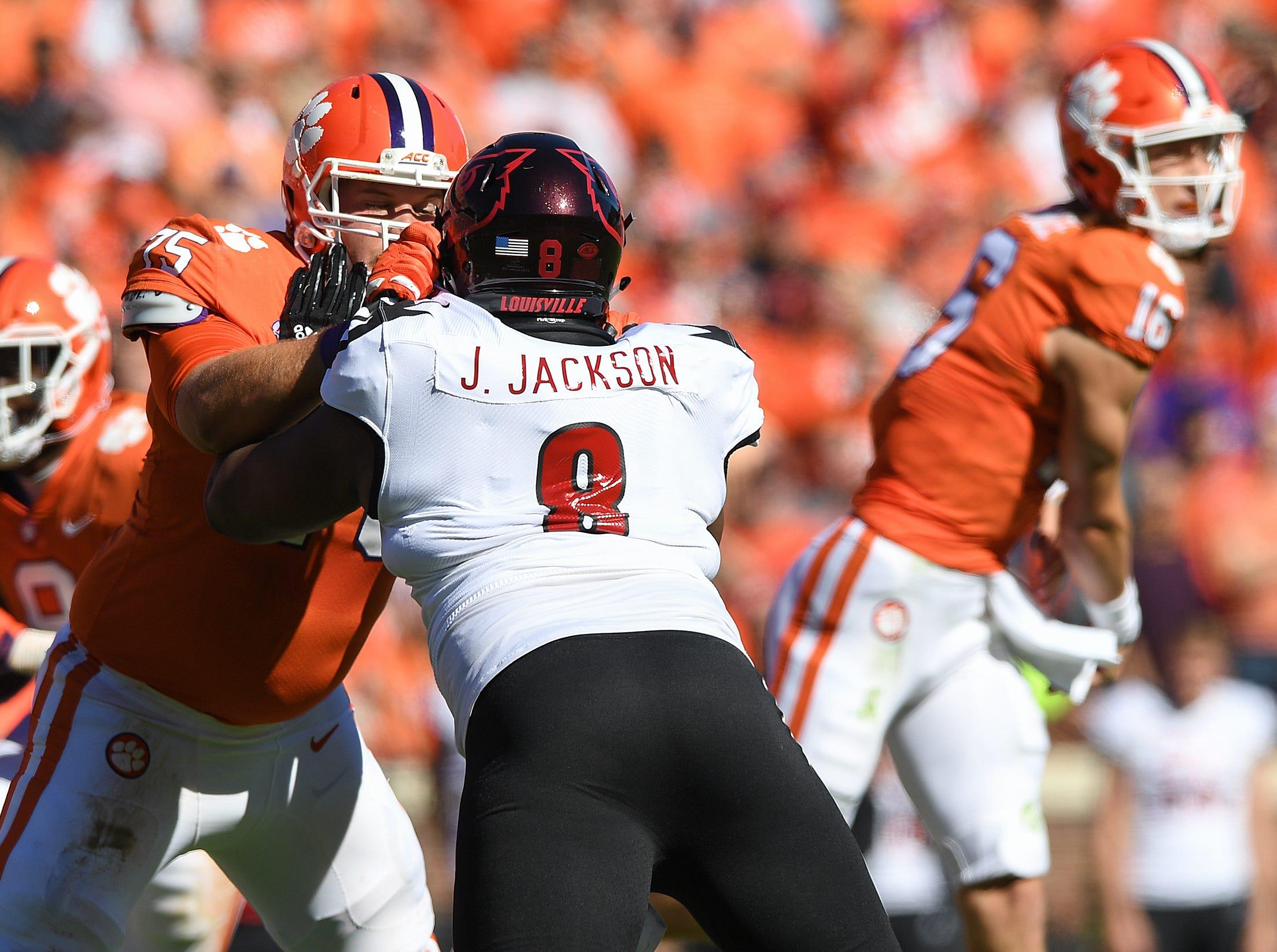 Clemson offensive lineman Mitch Hyatt (75) blocks Louisville defensive end Jarrett Jackson (8) during the 1st quarter Saturday, November 3, 2018 at Clemson's Memorial Stadium.