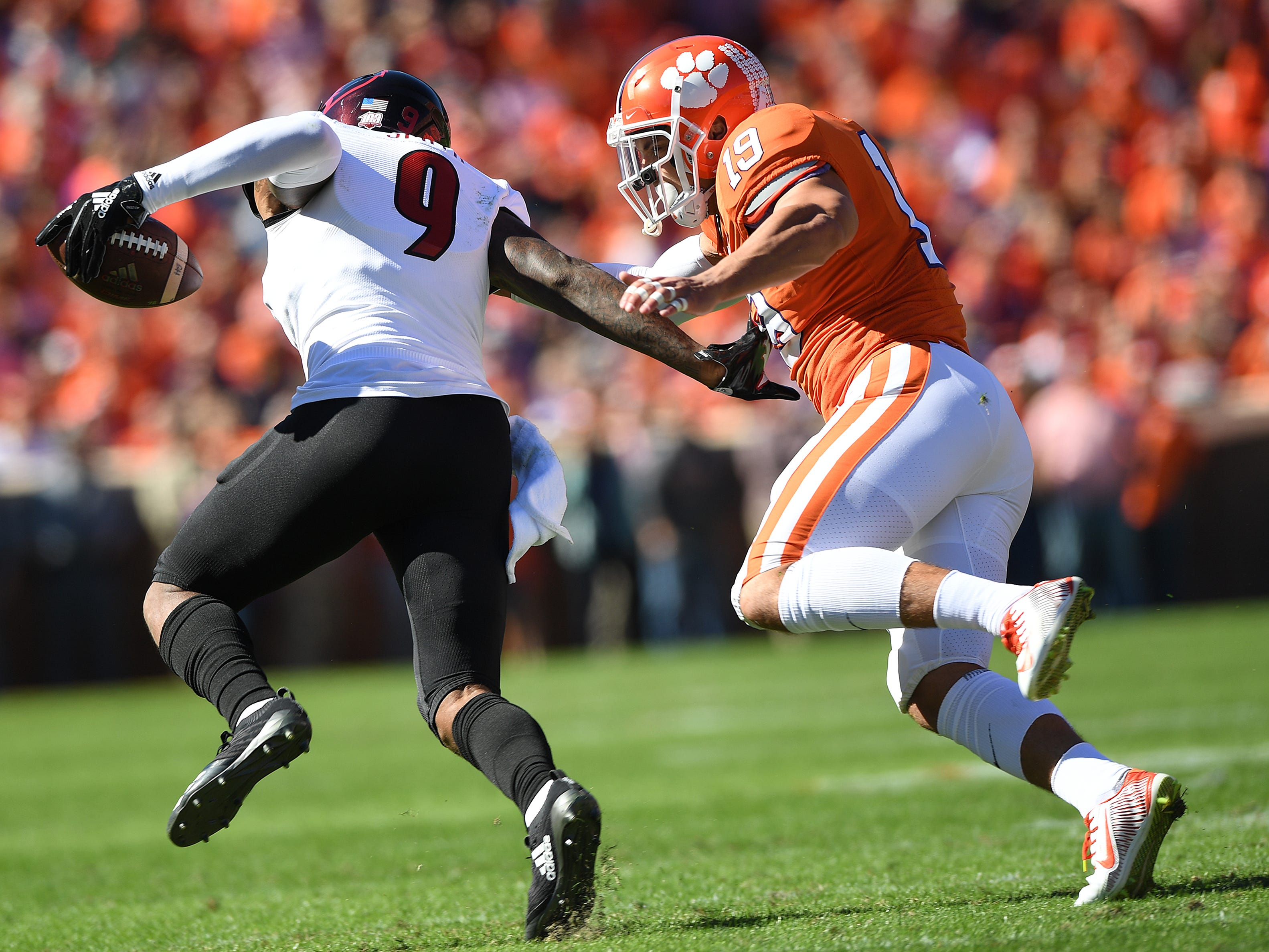 Clemson defensive back Tanner Muse (19) brings down Louisville wide receiver Jaylen Smith (9) during the 2nd quarter Saturday, November 3, 2018 at Clemson's Memorial Stadium.