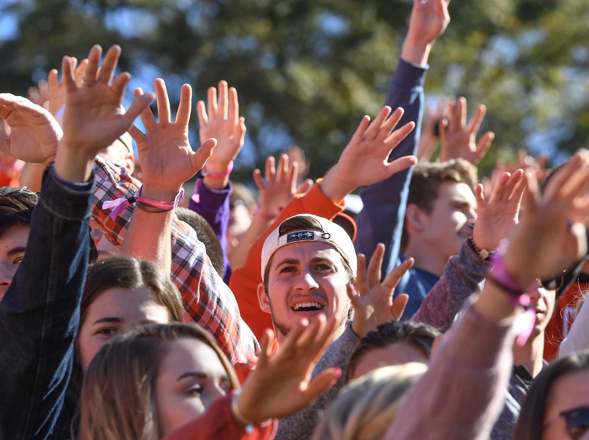 Clemson fans join in the alma mater before the Louisville game in Memorial Stadium on Saturday, November 3, 2018.