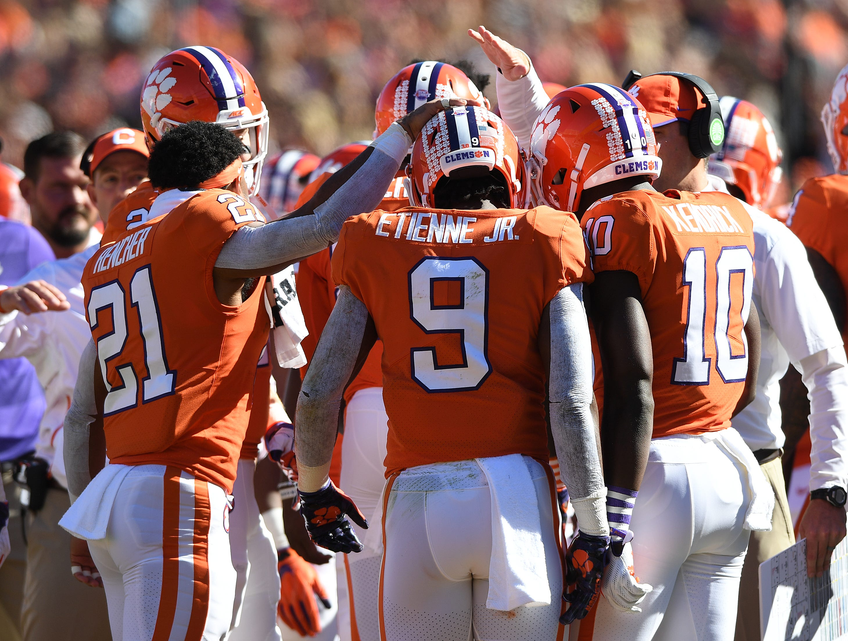Clemson running back Travis Etienne (9) is congratulated by teammates after scoring against Louisville during the 1st quarter Saturday, November 3, 2018 at Clemson's Memorial Stadium.