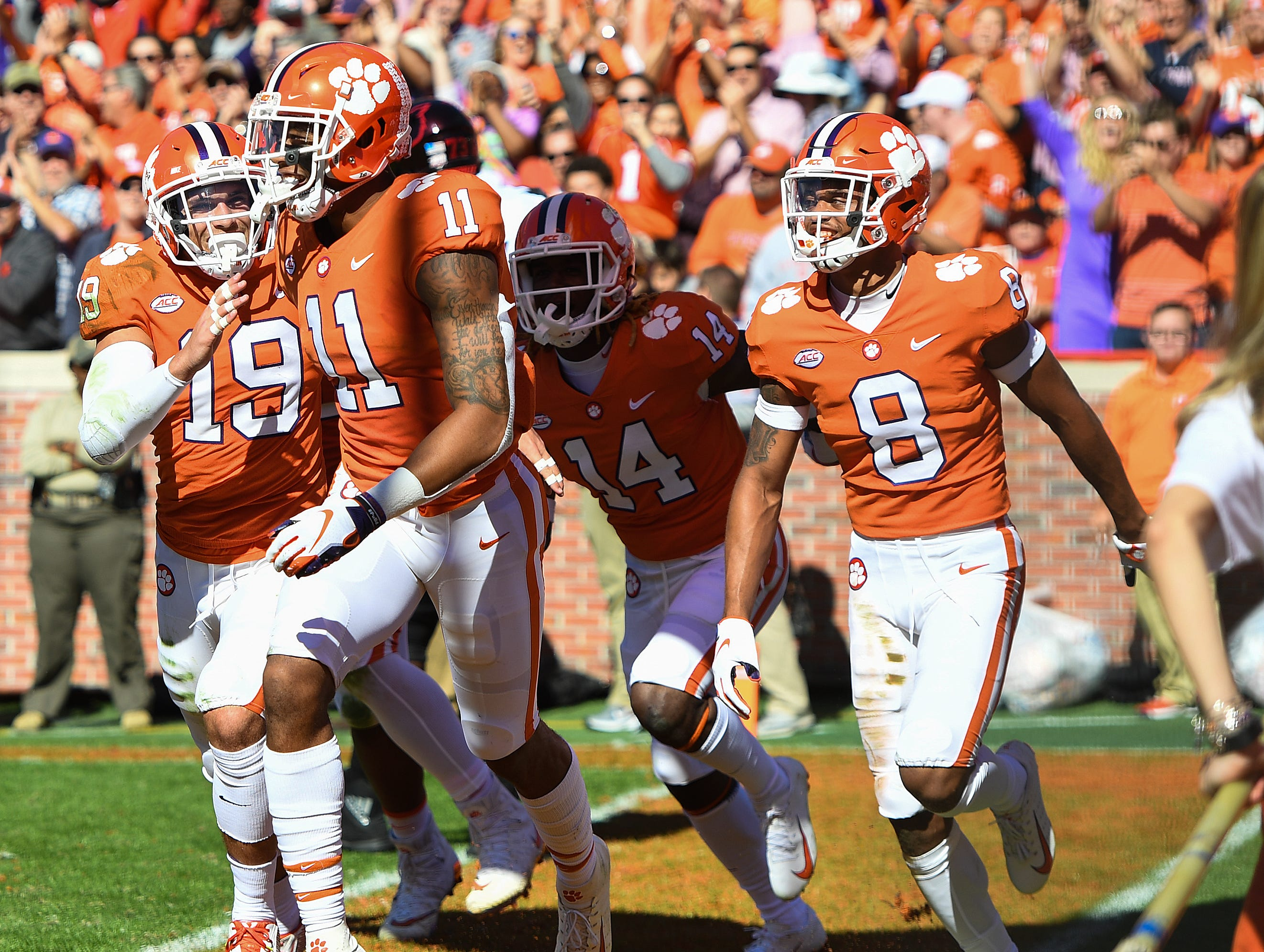 Clemson safety Isaiah Simmons (11) celebrates after scoring after intercepting a Louisville pass during the 2nd quarter Saturday, November 3, 2018 at Clemson's Memorial Stadium.