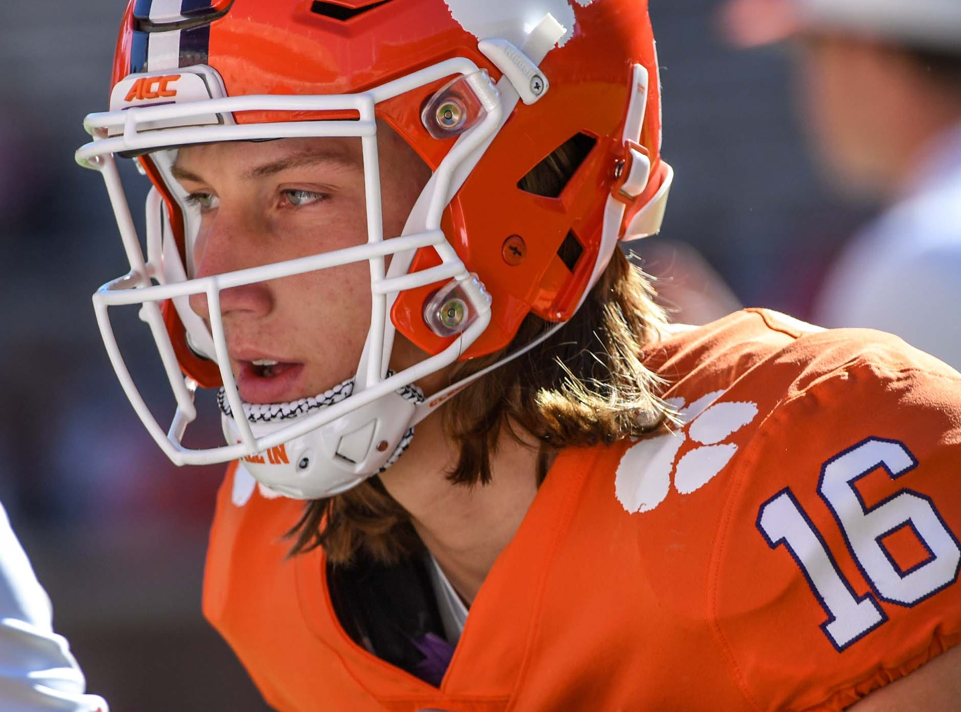 Clemson quarterback Trevor Lawrence (16) warms before the Louisville game in Memorial Stadium on Saturday, November 3, 2018.