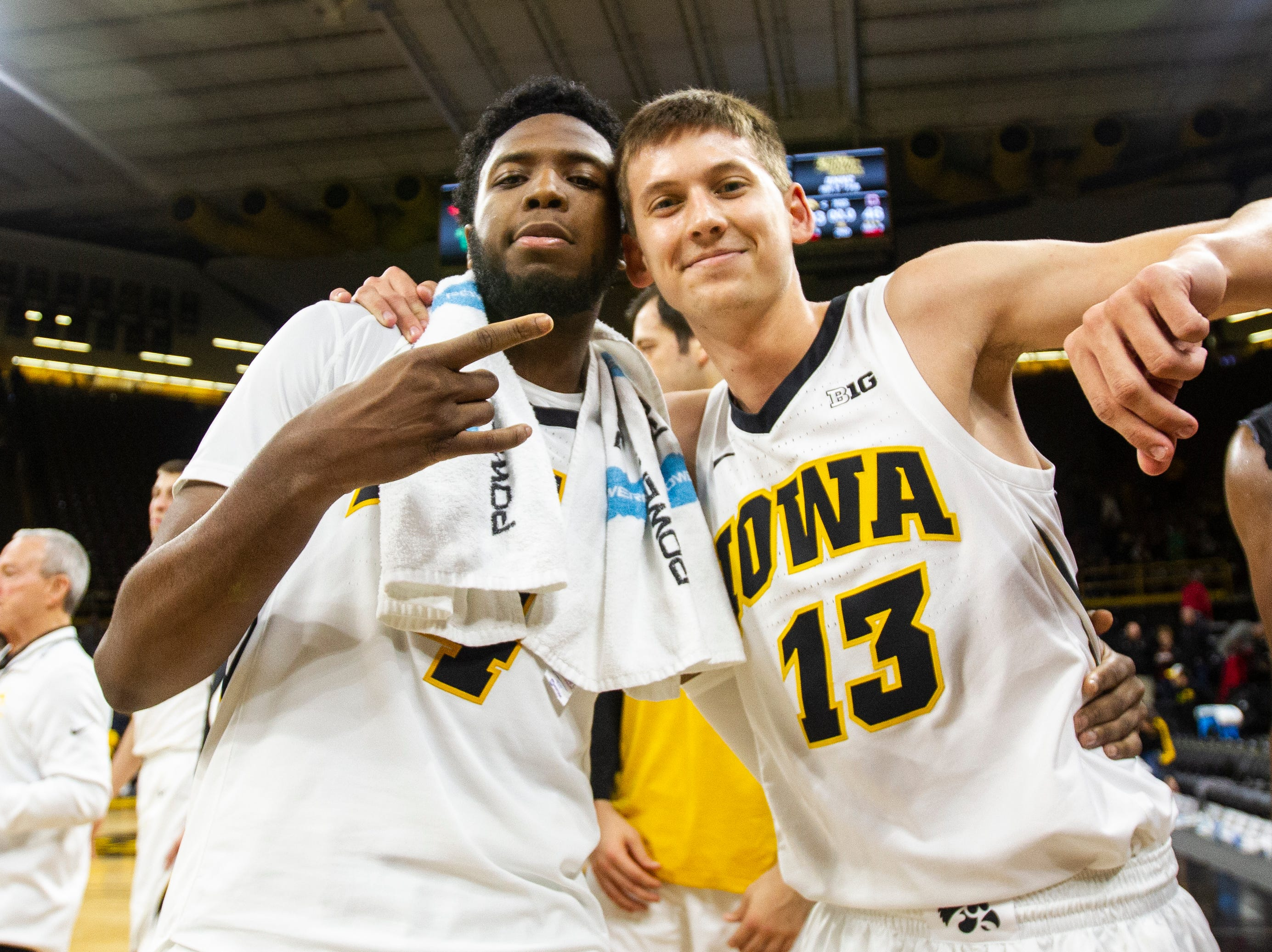 Iowa guard Isaiah Moss (4) and Iowa guard Austin Ash (13) pose for a photo after a men's basketball exhibition game on Sunday, Nov. 4, 2018, at Carver-Hawkeye Arena in Iowa City. The Hawkeyes defeated the Quakers, 103-46.