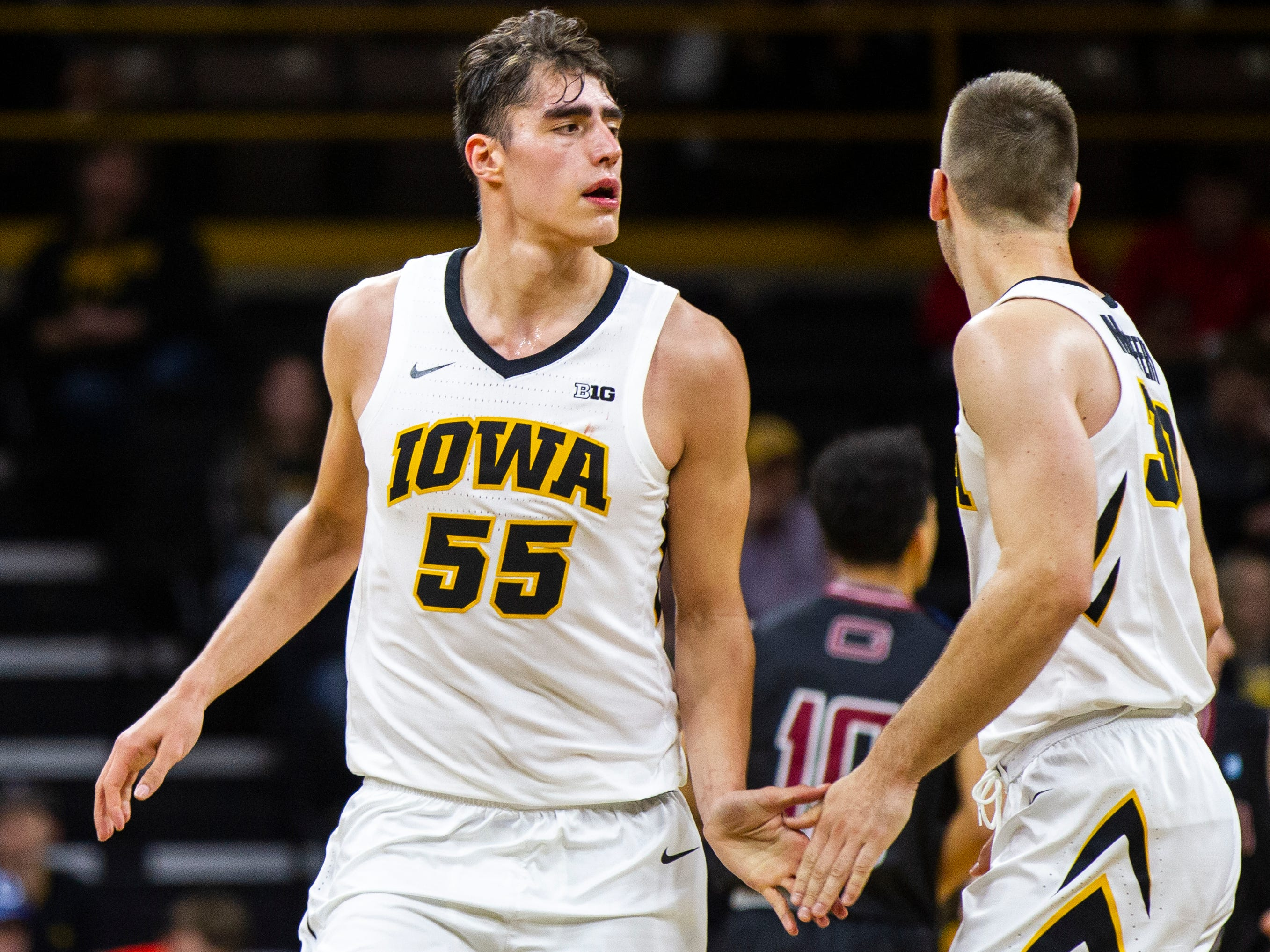 Iowa forward Luka Garza (55) gets a high-five from Iowa guard Connor McCaffery (30) during a men's basketball exhibition game on Sunday, Nov. 4, 2018, at Carver-Hawkeye Arena in Iowa City.