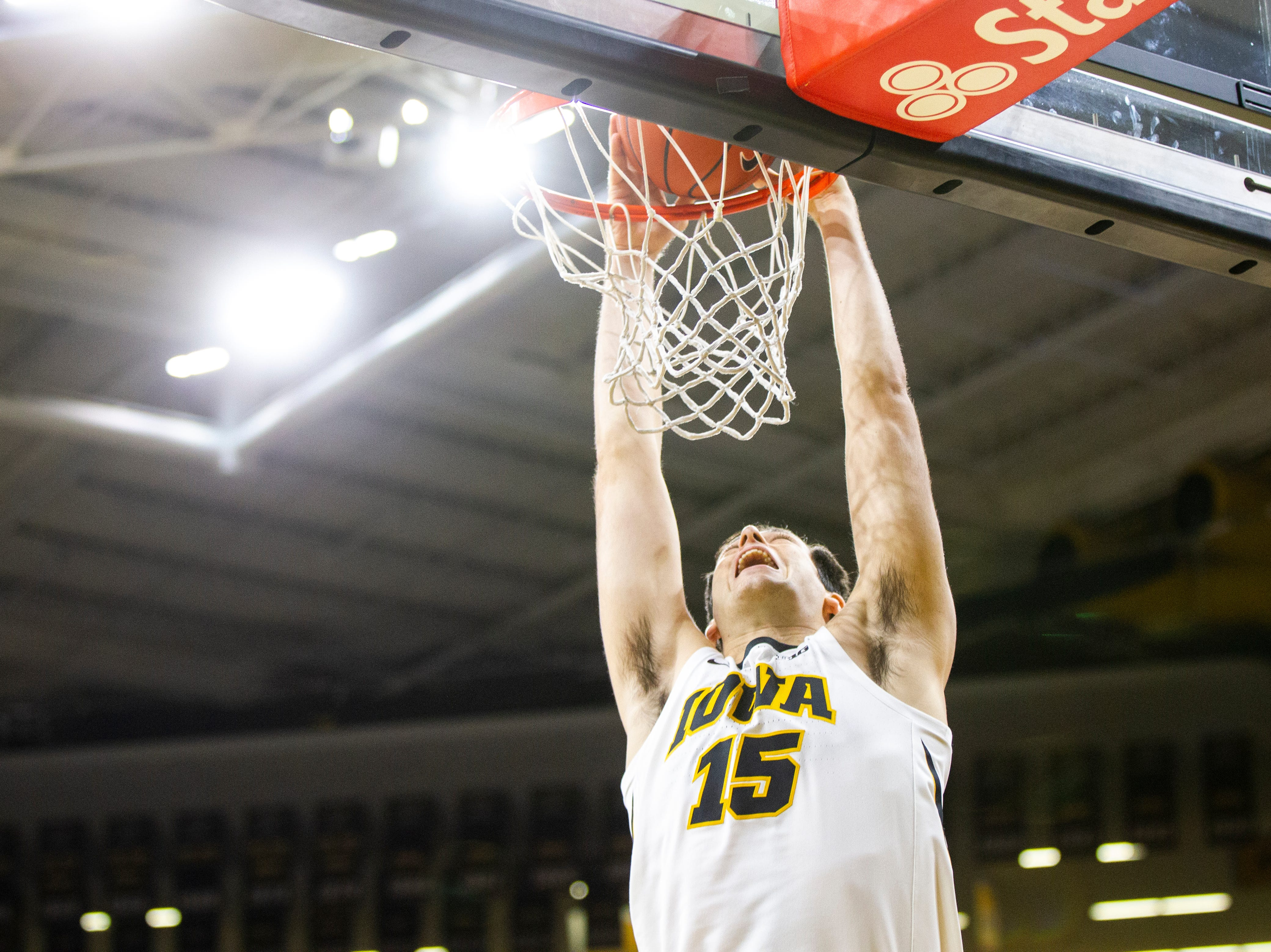 Iowa forward Ryan Kriener (15) dunks during men's basketball exhibition game on Sunday, Nov. 4, 2018, at Carver-Hawkeye Arena in Iowa City.
