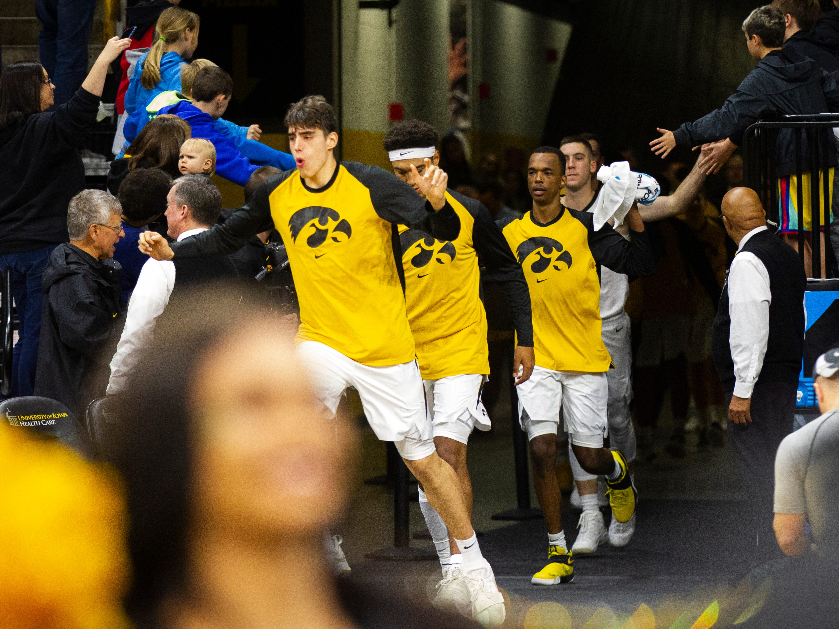 Iowa players take the court before a men's basketball exhibition game on Sunday, Nov. 4, 2018, at Carver-Hawkeye Arena in Iowa City.