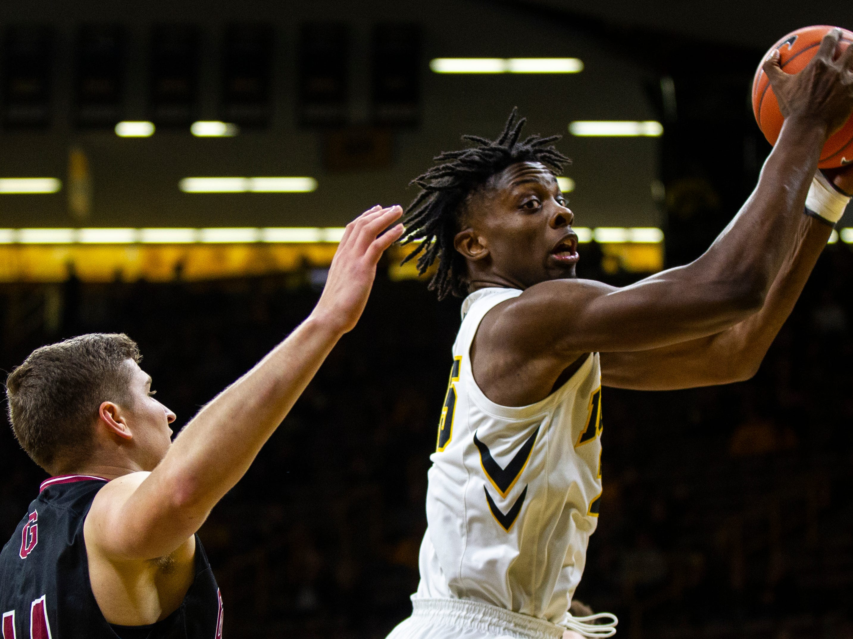 Iowa forward Tyler Cook (25) grabs a rebound during men's basketball exhibition game on Sunday, Nov. 4, 2018, at Carver-Hawkeye Arena in Iowa City.
