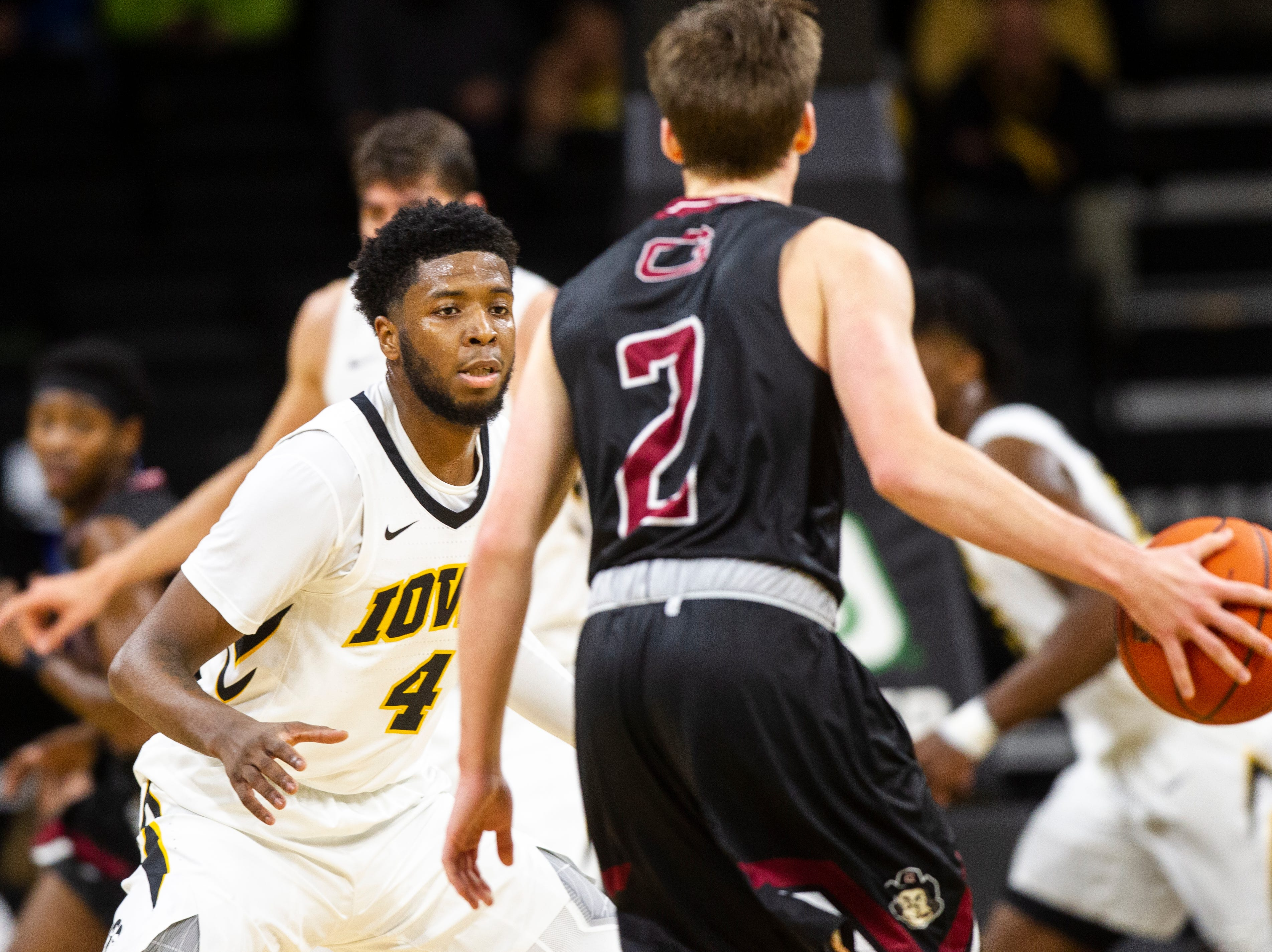 Iowa guard Isaiah Moss (4) defends Guilford's Joah Logan (2) during a men's basketball exhibition game on Sunday, Nov. 4, 2018, at Carver-Hawkeye Arena in Iowa City.
