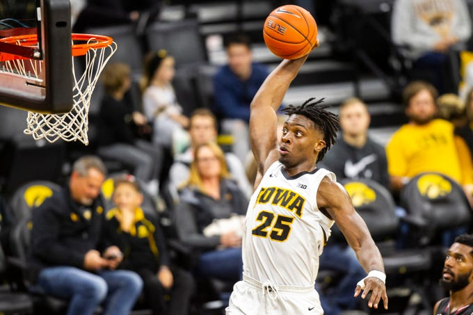 Iowa forward Tyler Cook (25) dunks during men's basketball exhibition game on Sunday, Nov. 4, 2018, at Carver-Hawkeye Arena in Iowa City.
