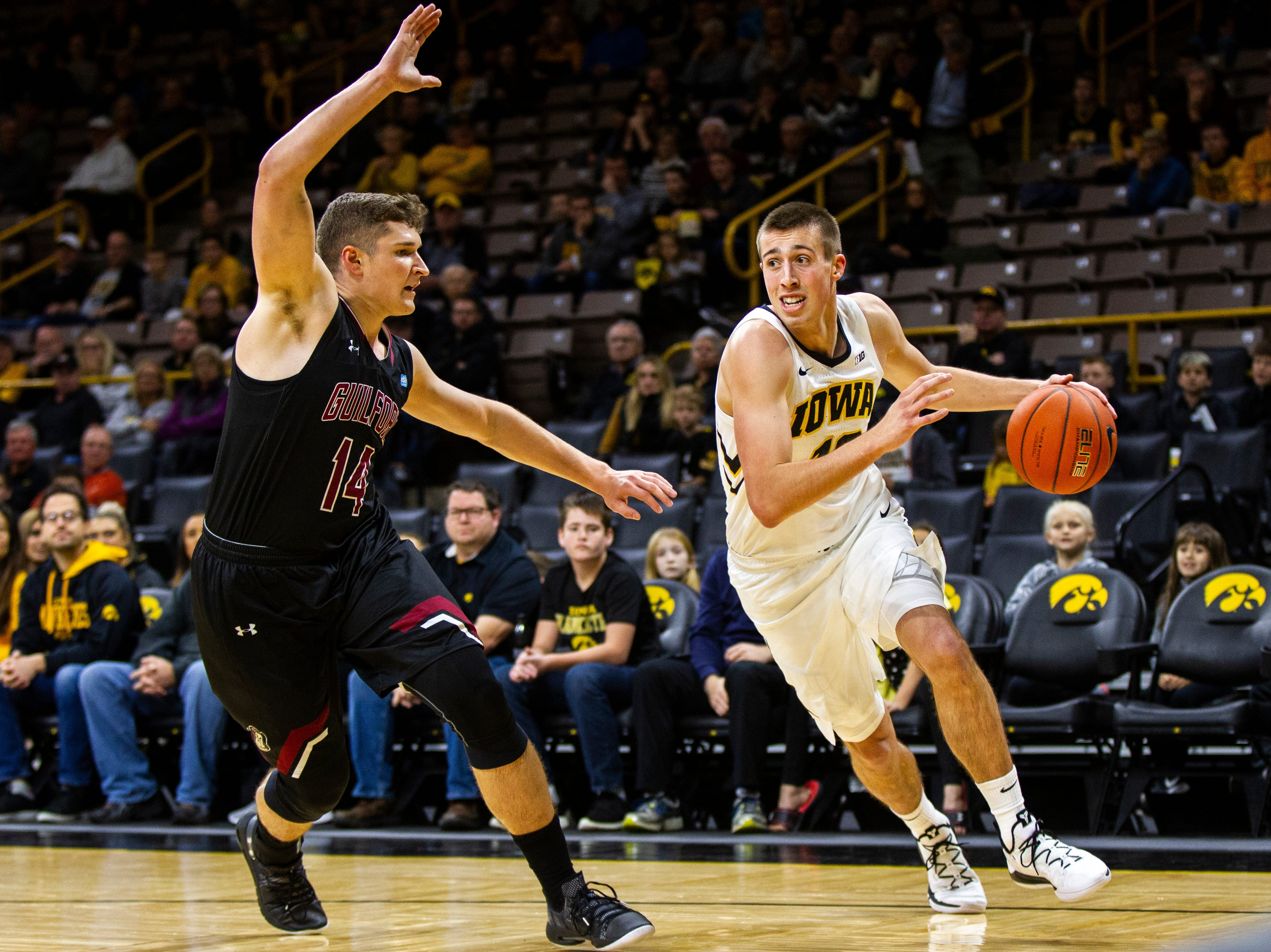 Iowa guard Joe Wieskamp (10) drives to the hoop past Guilford's Carson Long (14) during a men's basketball exhibition game on Sunday, Nov. 4, 2018, at Carver-Hawkeye Arena in Iowa City.