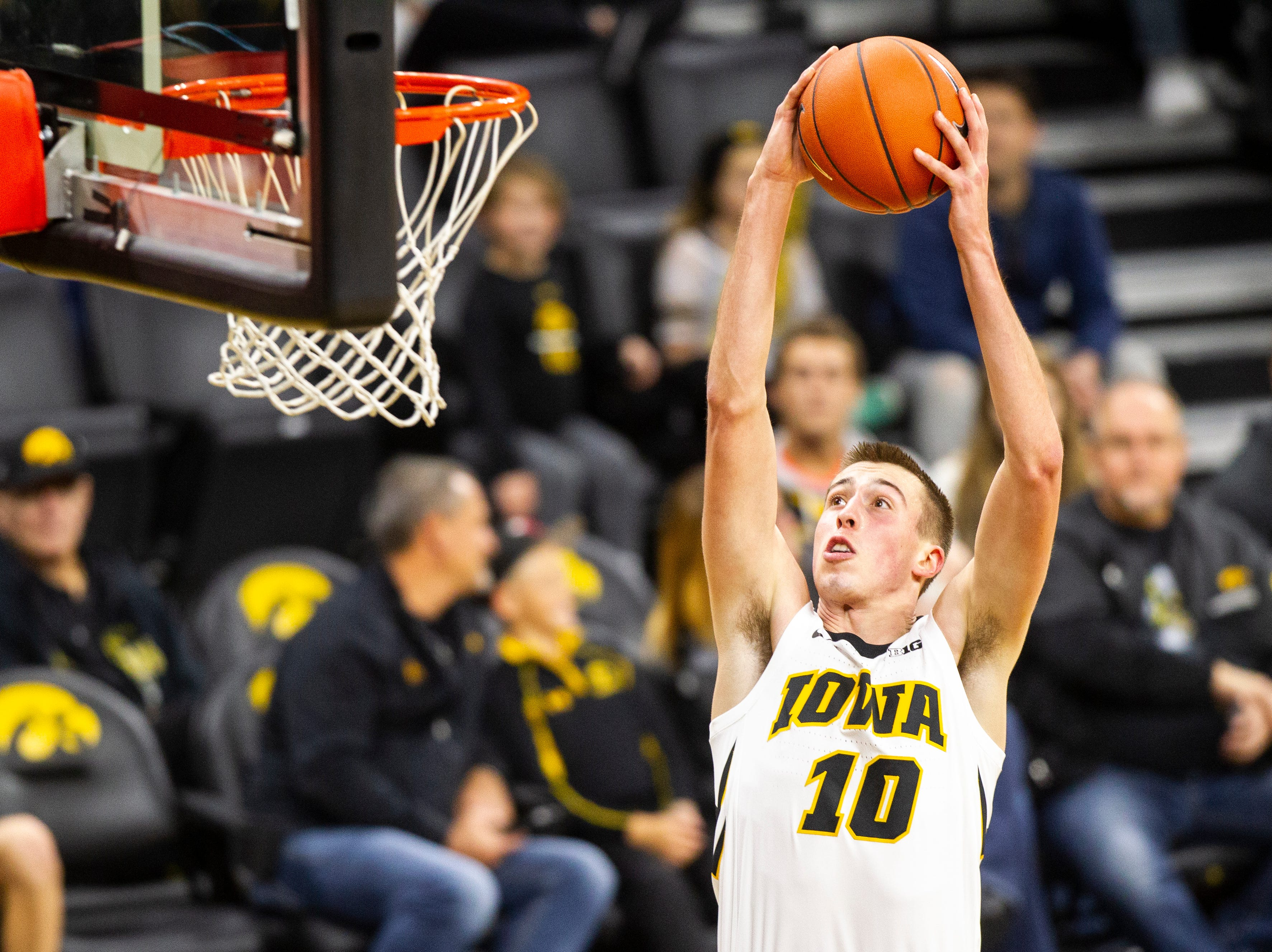 Iowa guard Joe Wieskamp (10) dunks during men's basketball exhibition game on Sunday, Nov. 4, 2018, at Carver-Hawkeye Arena in Iowa City.