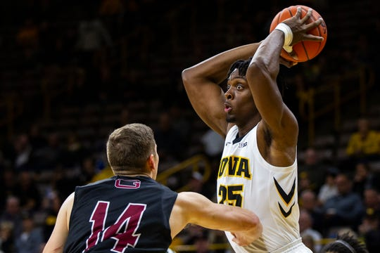Iowa power forward Tyler Cook looks to pass during an exhibition win Sunday. He led the Hawkeyes with seven assists and nine rebounds.