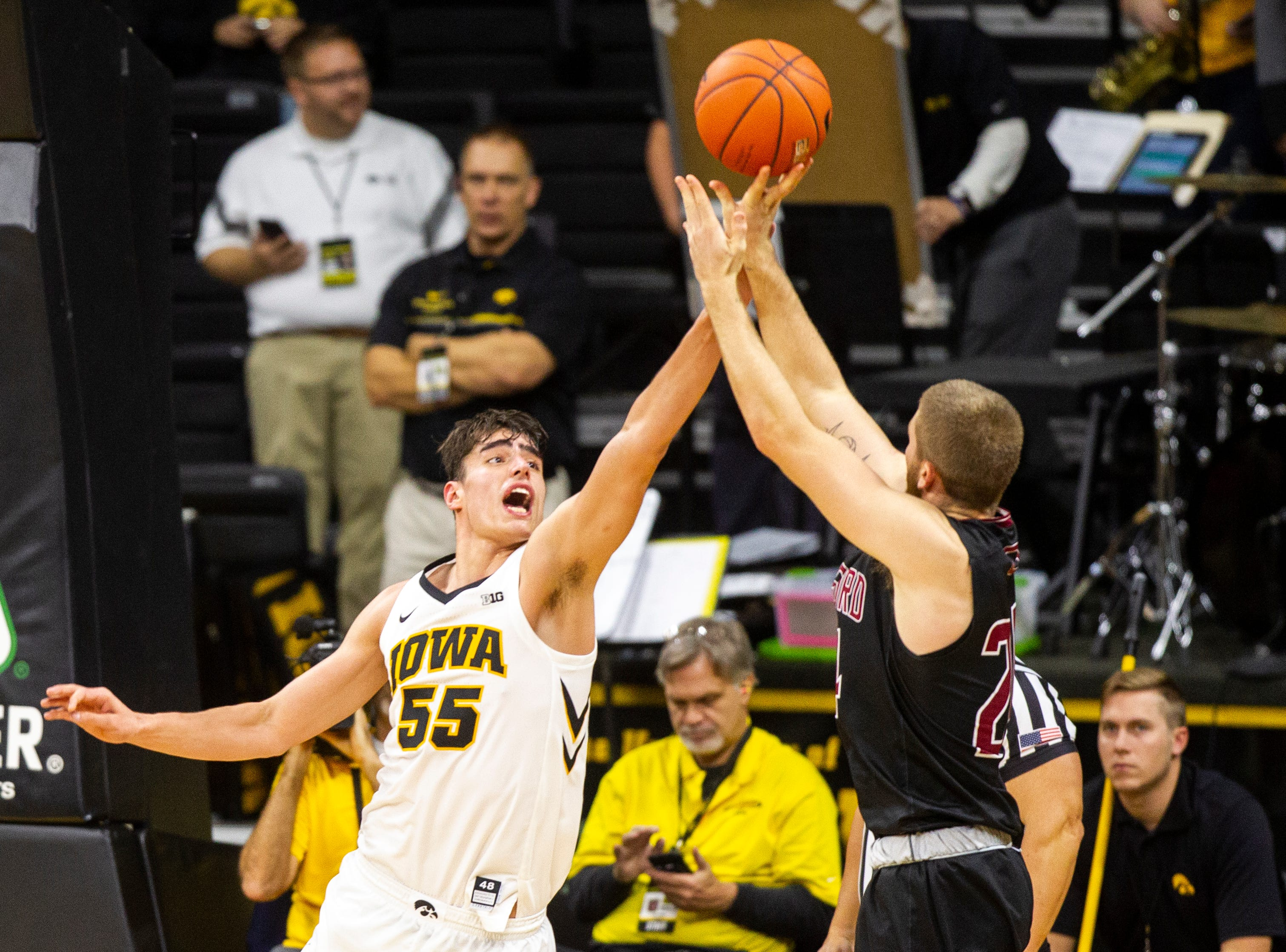 Iowa forward Luka Garza (55) attempts to block Guildford's Kyler Gregory (24) shot during a men's basketball exhibition game on Sunday, Nov. 4, 2018, at Carver-Hawkeye Arena in Iowa City.